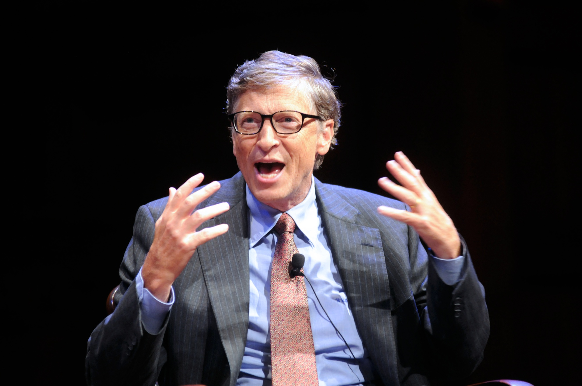 Bill Gates jokes about his reputation for not attending classes in his Harvard years with financier David M. Rubenstein during the public launch of The Harvard Campaign on Saturday. The two met for a discussion about philanthropy in Sanders Theatre as part of the weekend's launch events.