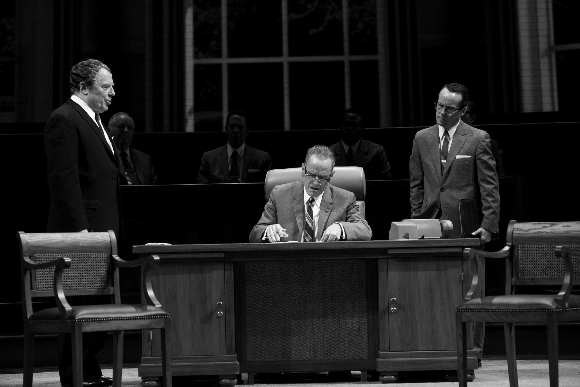"""Lyndon B. Johnson (Bryan Cranston) makes decisions from his iconic desk chair in the ART's production of """"All the Way."""""""