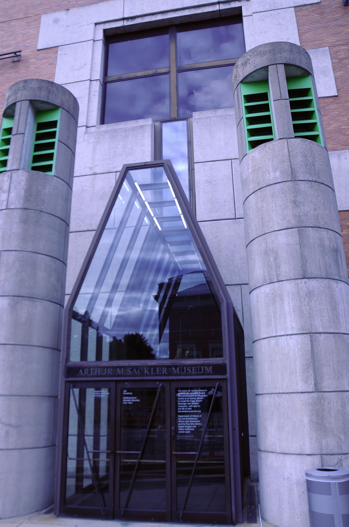 These modern geometric glass doors mark the entrance to the Arthur M. Sackler Museum.