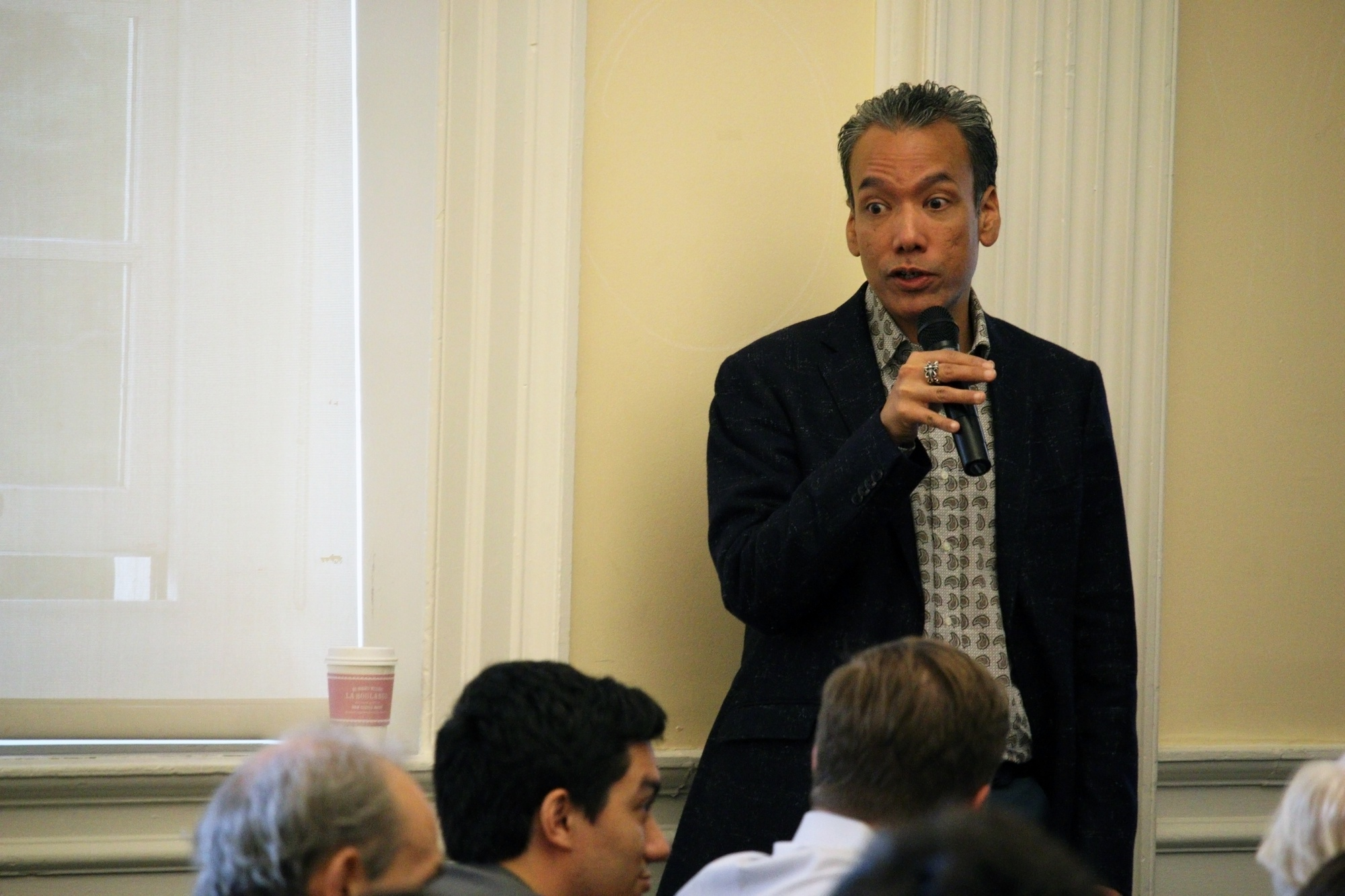 Professor Robert Lue prompts the audience for questions about HarvardX during a town hall meeting Thursday evening in Harvard Hall. Lue and fellow faculty members discussed courses, research, and objectives of HarvardX going forward.