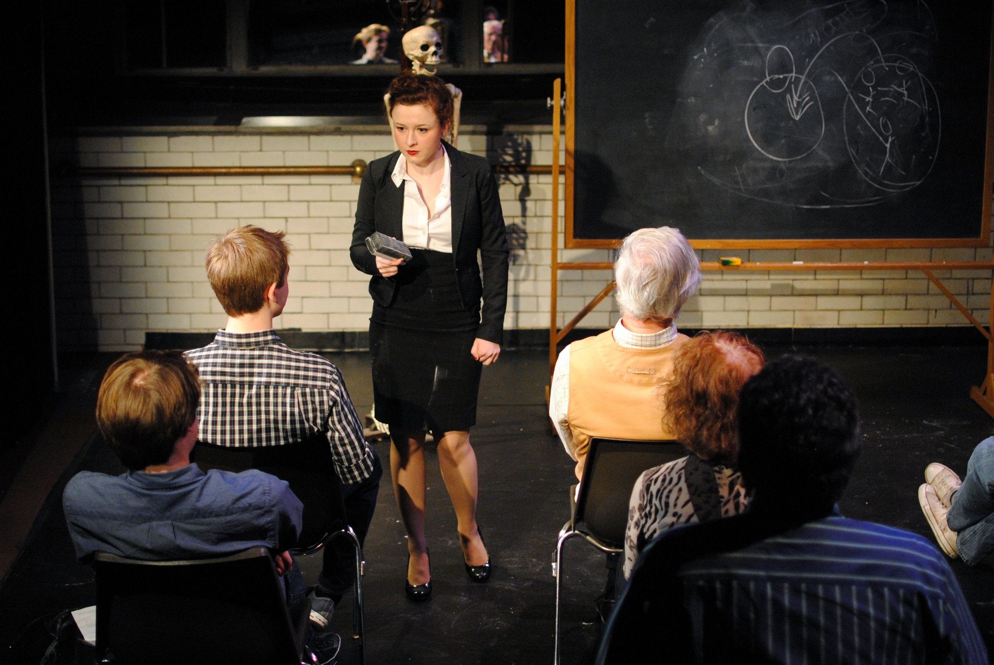 "Elizabeth K. Leimkuhler '15 presides over her class in a production of ""Miss Margarida's Way"" in the Adams Pool Theatre."