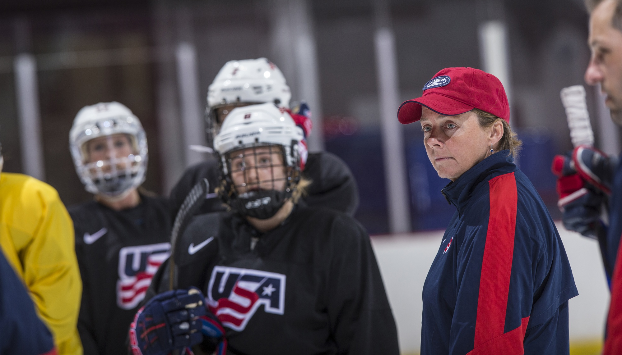 Seen here while the coach of the 2014 USA Women's Olympic Hockey team, coach Stone seeks her second national championship at the helm of the Harvard women's ice hockey program.