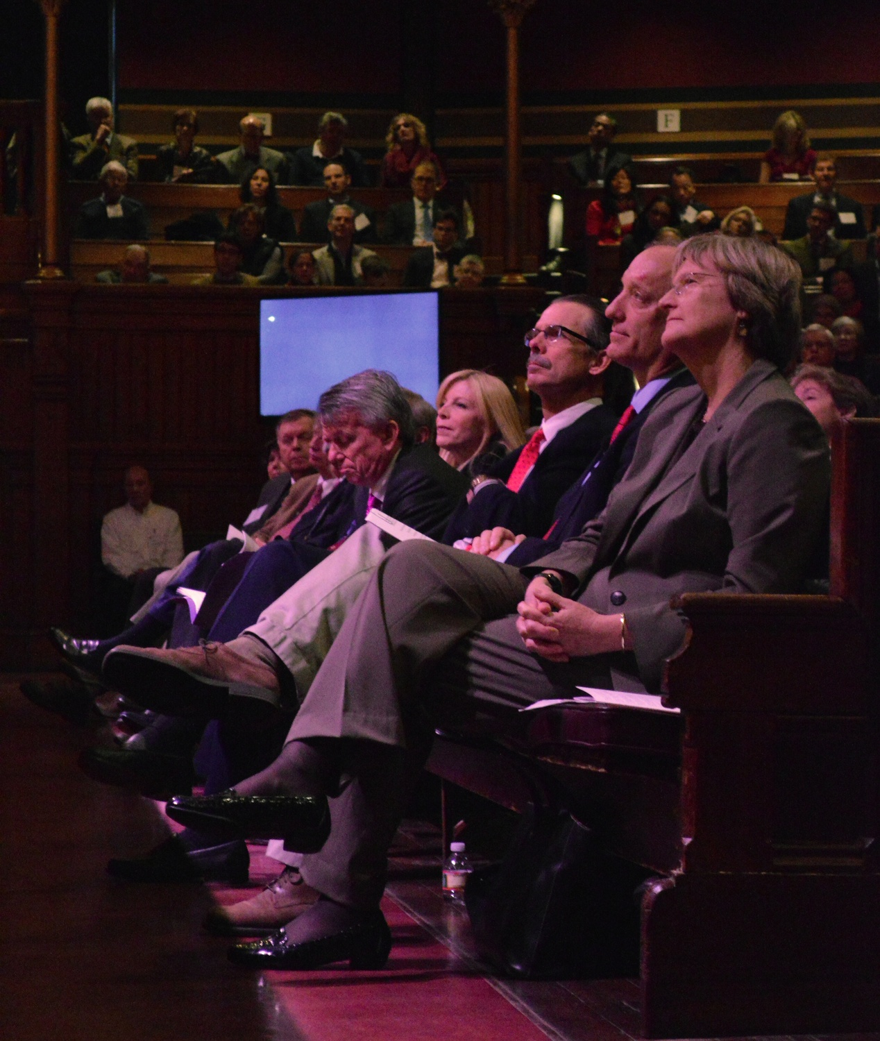 From right to left, University Drew G. Faust, FAS Dean Michael D. Smith, and campaign co-chairs Glenn H. Hutchins '77, Paul B. Edgerley, and Sandra M. Edgerley '84 watch FAS campaign co-chair Carl J. Martignetti '81 address the crowd at the FAS campaign launch event in Sanders Theatre in 2013.