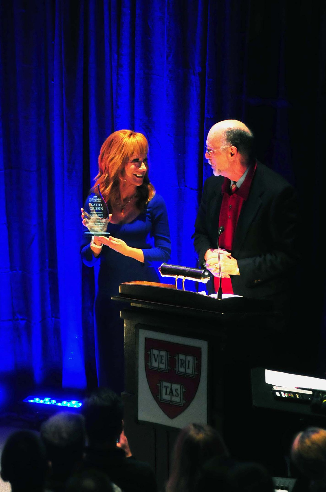 "Interim Dean of Harvard College Donald H. Pfister presents comedian and veteran advocate Kathy Griffin with the 2013 Distinguished Service Partner award at ""Standing Tall for Veterans,"" a comedy charity benefit for the Home Base Program presented by the Harvard Undergraduates Honoring Veterans on Saturday afternoon."