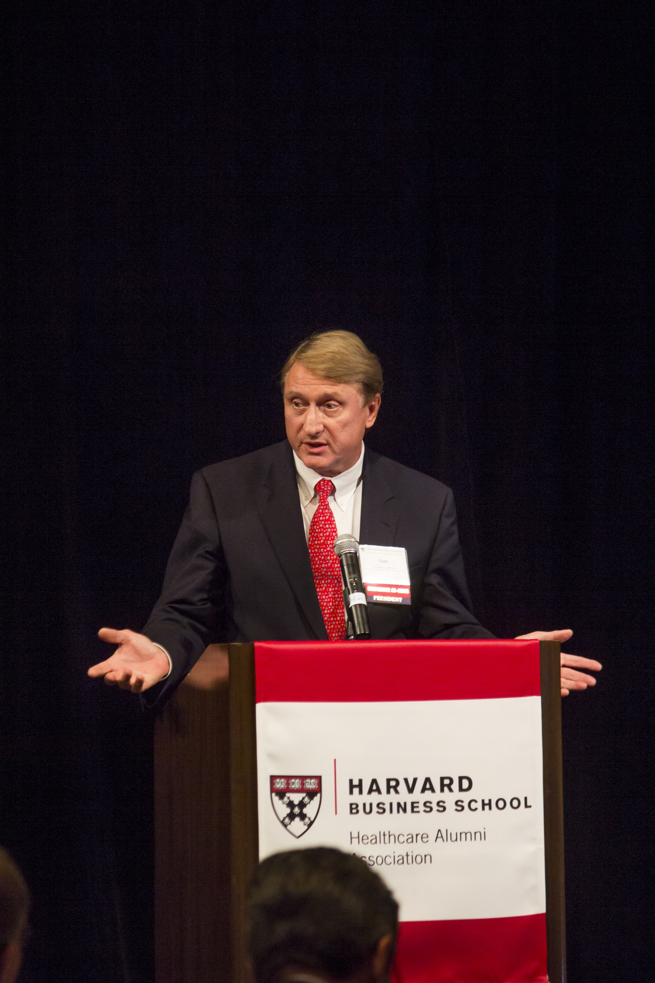 Tom Robinson, president of the HBS Healthcare Alumni Association, gives the keynote speach to kick off the two-day long Alumni conference.