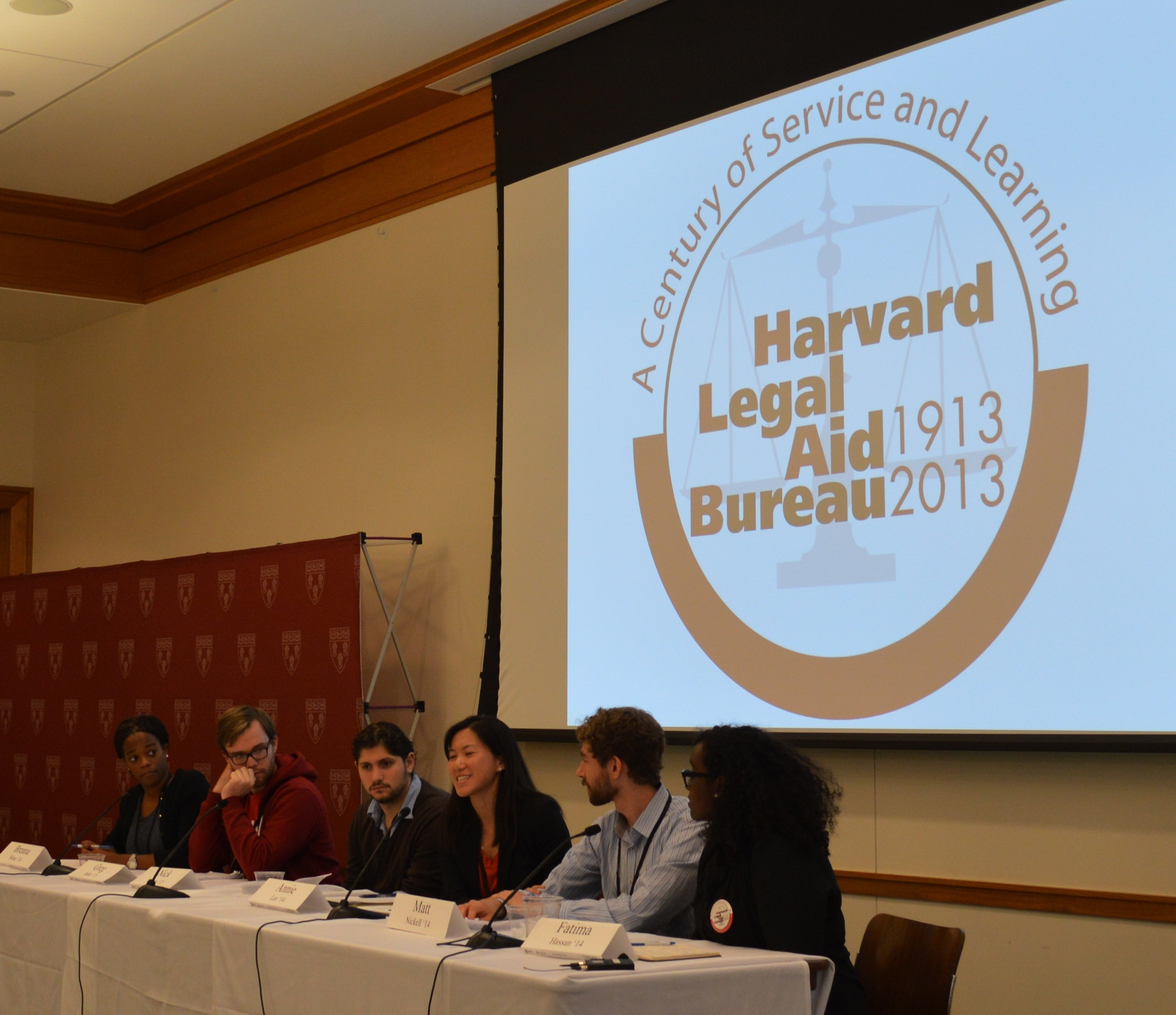 Members of the present Harvard Legal Aid Bureau answer questions in a town hall meeting at the 100th HLAB aniversary. The Harvard Legal Aid Bureau has been providing legal services to low-income individuals free of charge for the past century.