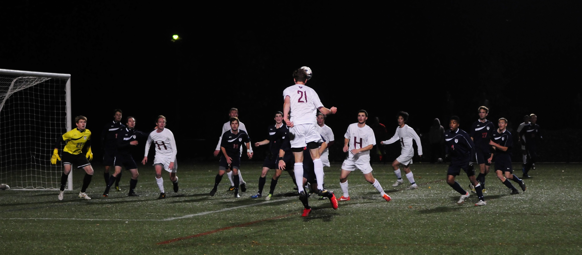 Senior Kevin Harrington takes a header after a corner kick by classmate Ross Friedman. Two early goals allowed Penn to take the win over Harvard, 2-0.