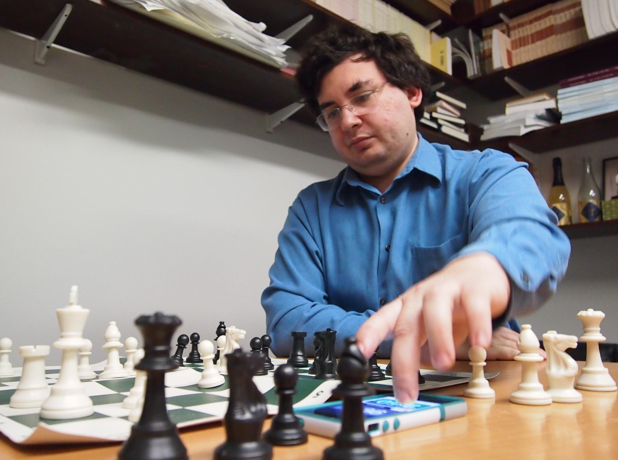 Harvard professor Joseph K. Blitzstein makes a move in a chess game against fellow Harvard professor Noam Elkies.