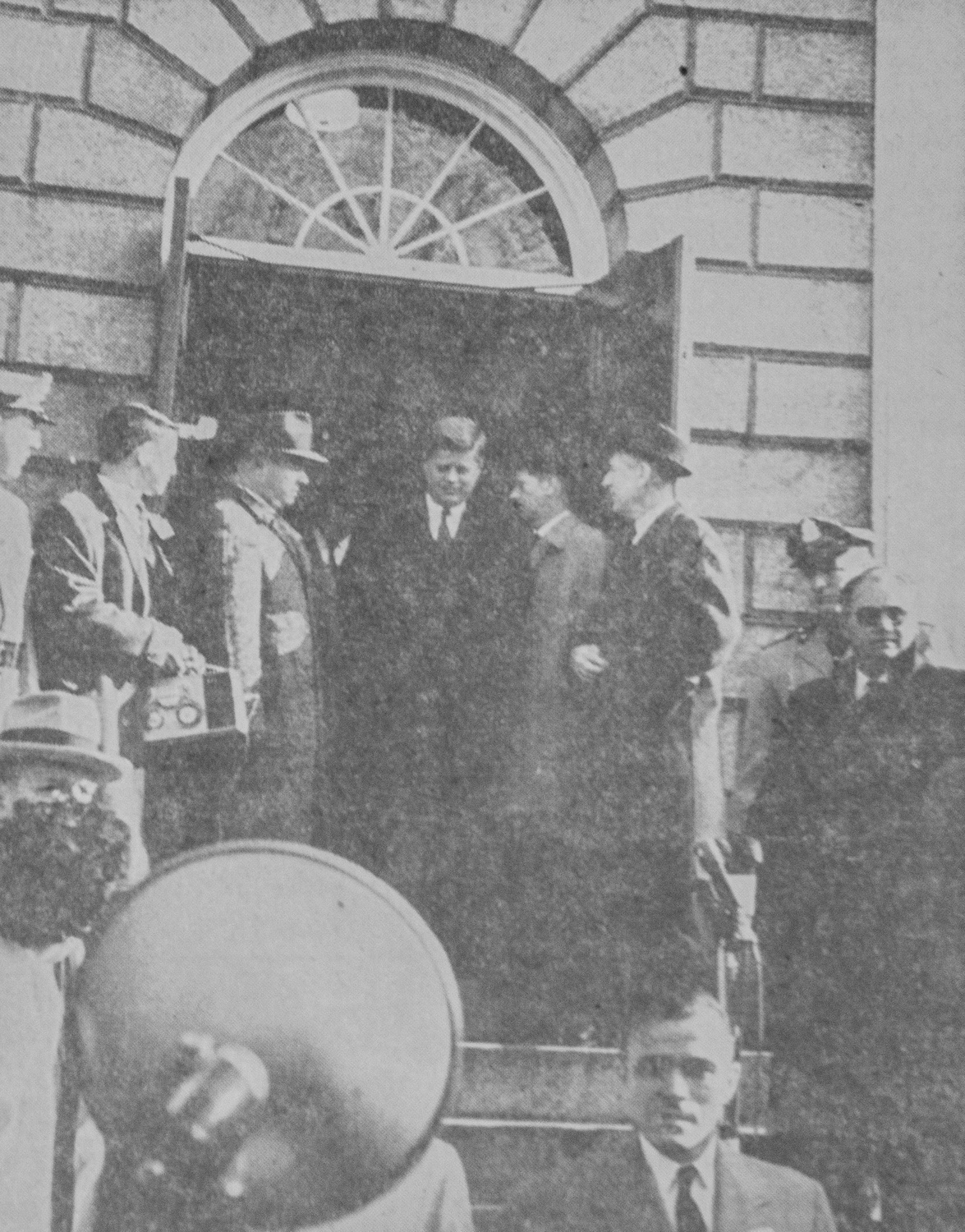 The President-elect leaves University Hall after his final meeting on the University Board of Overseers on January 9, 1961. The photograph ran on page four of the Tuesday, November 26, 1963, issue of The Crimson.