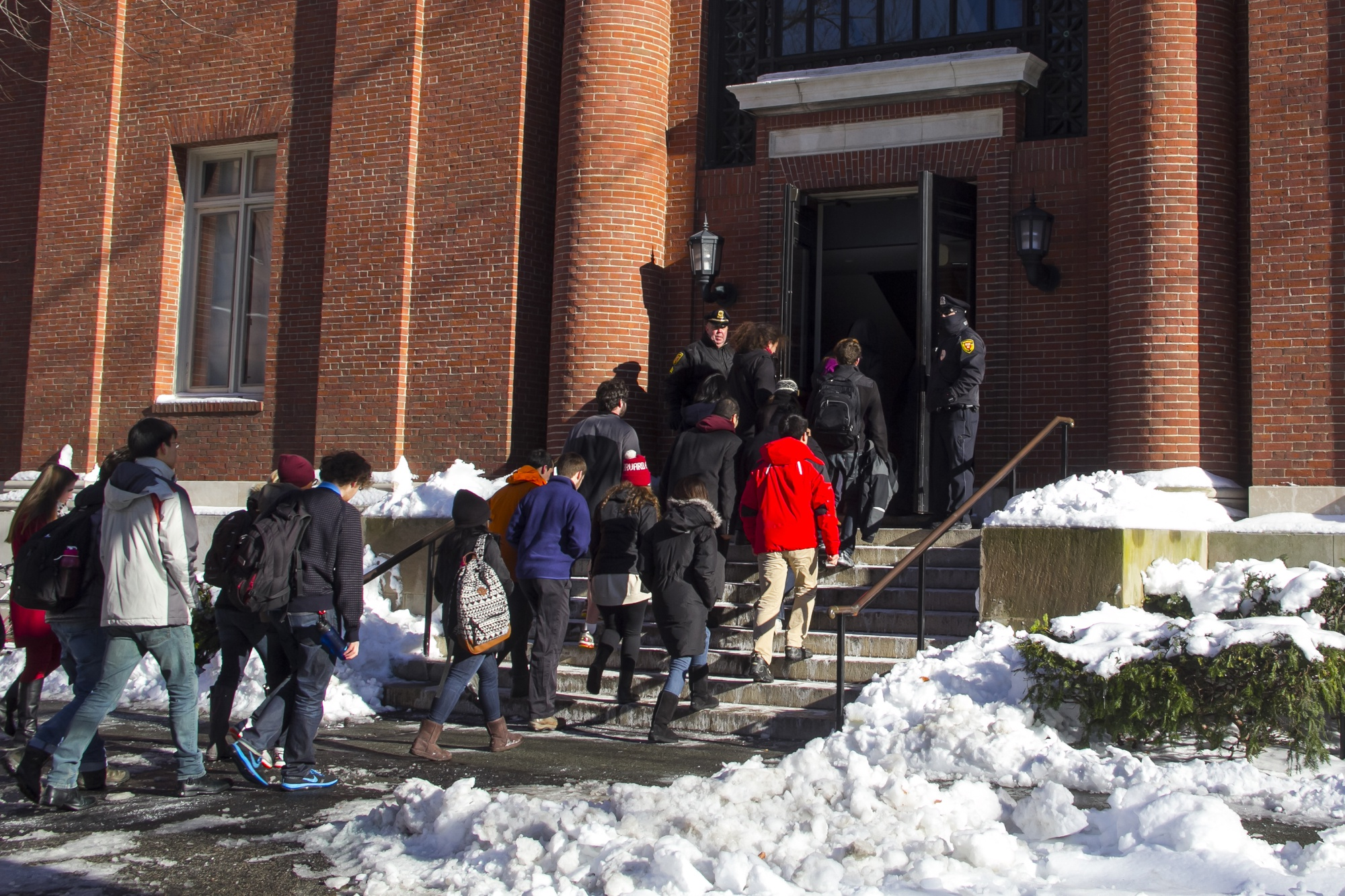Students enter Emerson Hall to take their final examinations after it had been deemed safe by University officials.