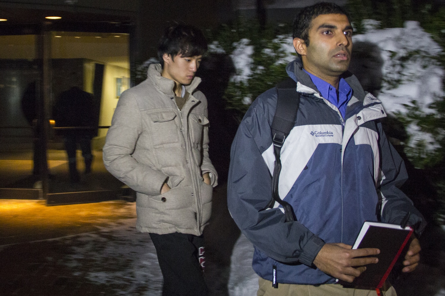 Eldo Kim, left, exits the federal courthouse in december after he has been released on bail awaiting further trial