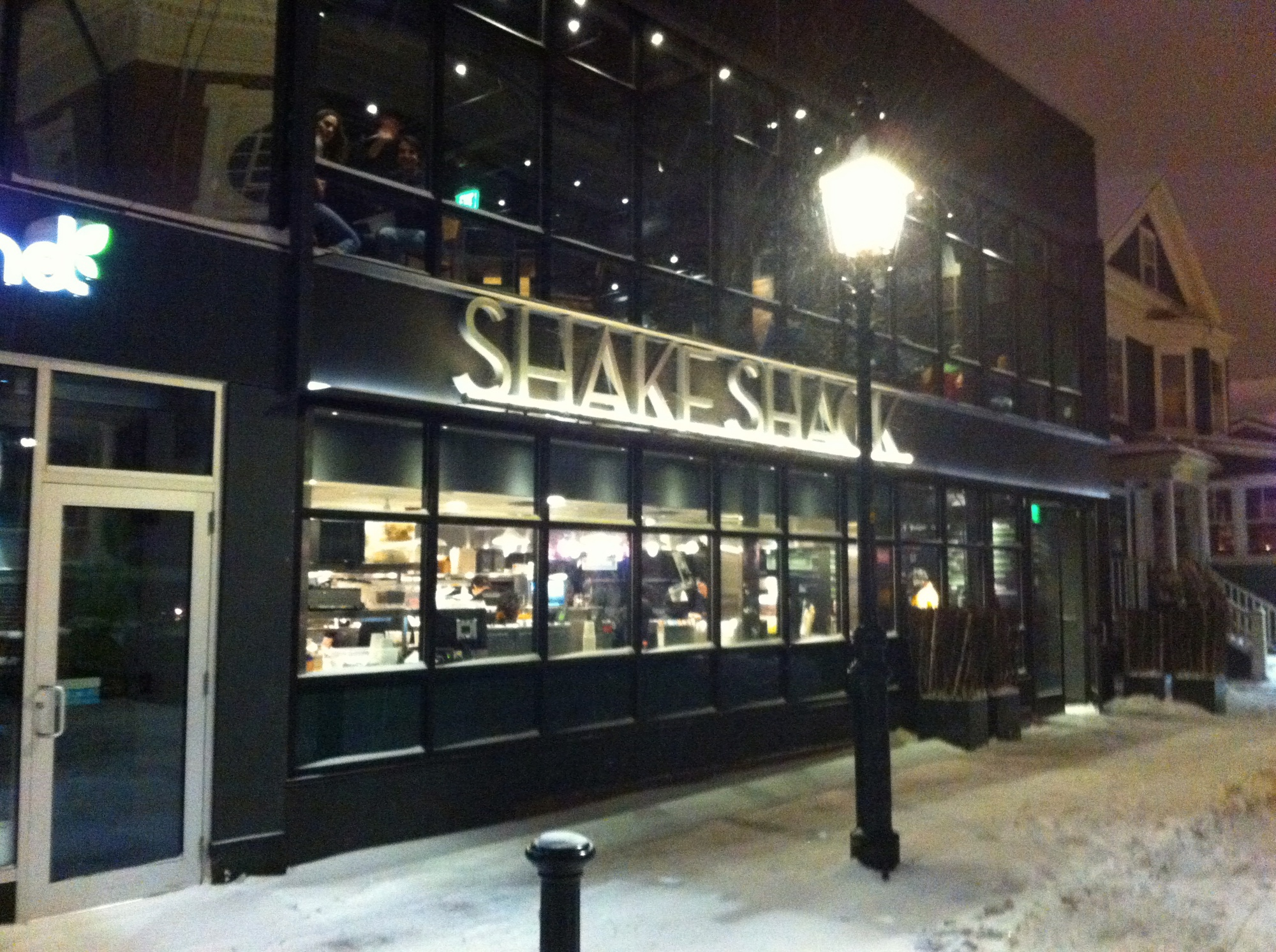 Shake Shack, Harvard Square's newest burger destination, remains open for its first full day of business Thursday despite a major winter storm impacting New England.