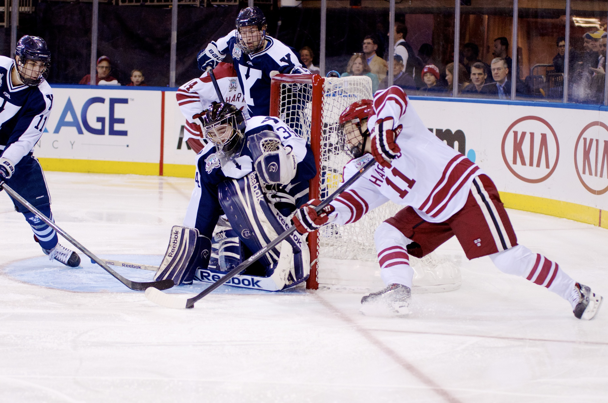 Sophomore forward Kyle Criscuolo attempts a shot on Yale goaltender Alex Lyon. Lyon held Harvard to just one goal, saving 23 of 24 shots.