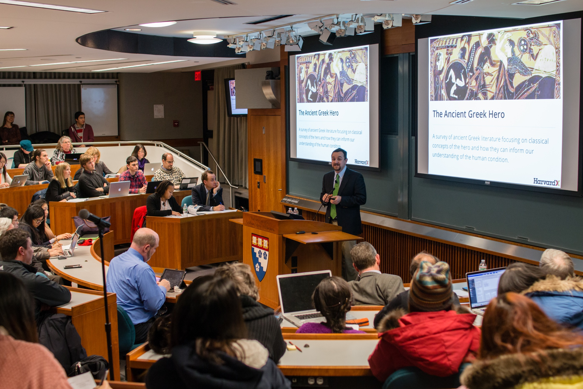 Justin Reich, HarvardX Research Fellow, briefly describes the HeroesX curriculum as an introduction to the findings discovered by analyzing the behavior of registered users of HarvardX courses. The HarvardX Research Presentation occurred on January 21 at Larsen Hall.