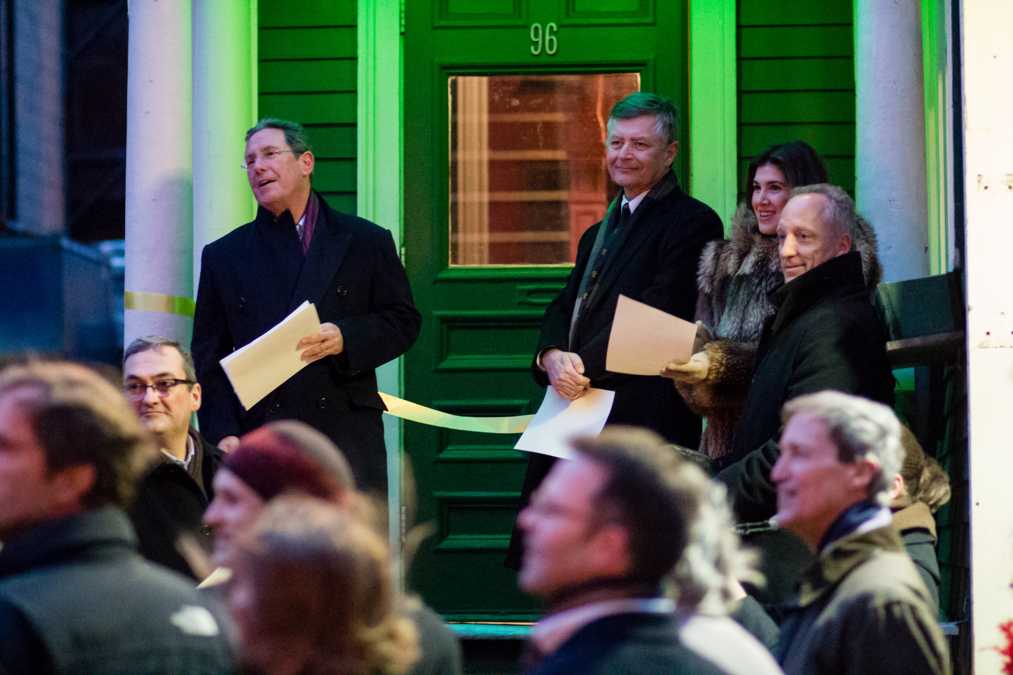 """""""Grand Sphinx"""" Andrew L. Farkas '82, far left, speaks at the dedication of the new Hasty Pudding Institute of 1770 clubhouse to a crowd that included Dean of the Faculty of Arts and Science Michael D. Smith, far right."""