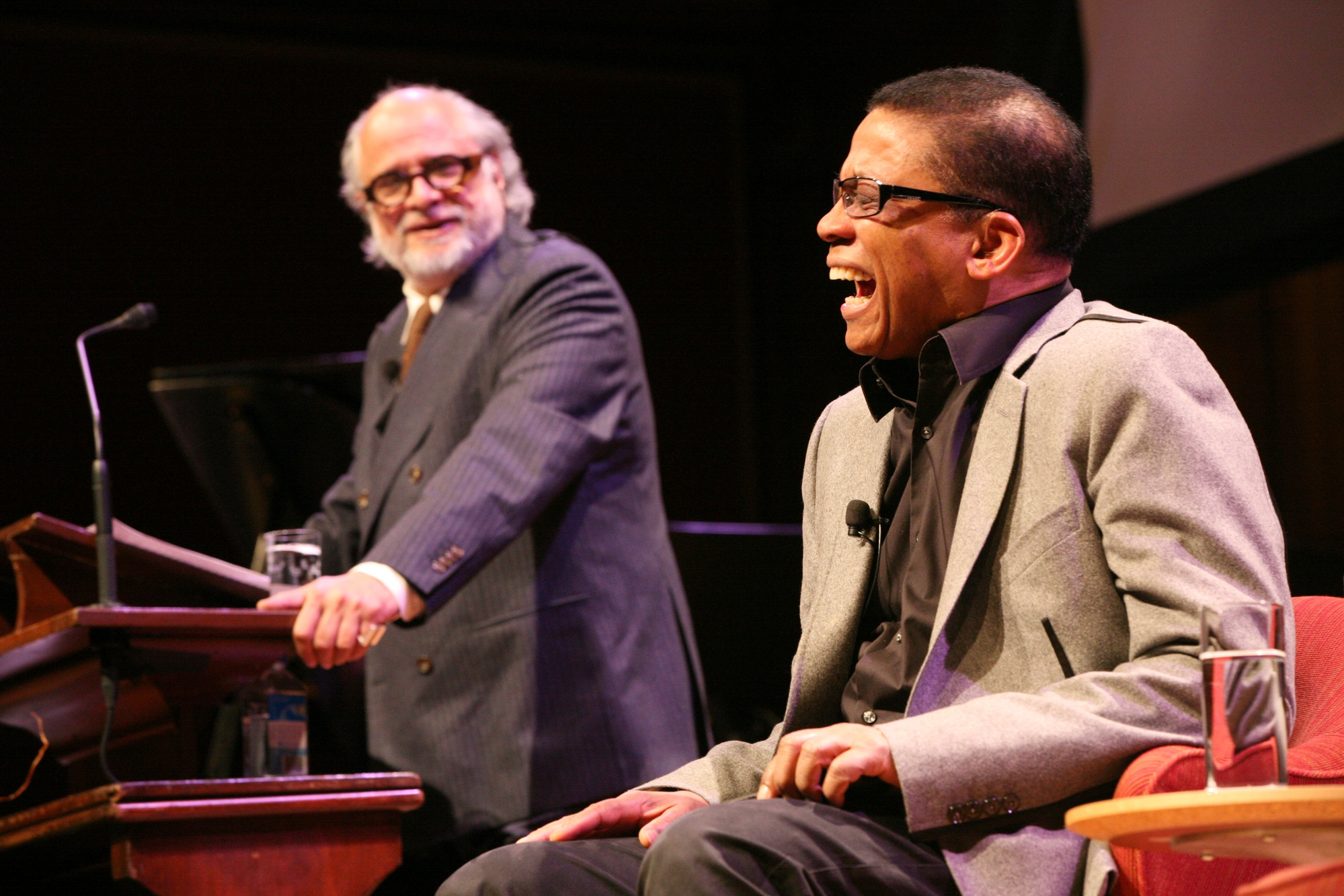 The 2014 Norton Lecturer, Herbie Hancock, bursts into laughter during the first set of his lecture series, 'The Ethics of Jazz' in Sanders Theatre on Feb 3.