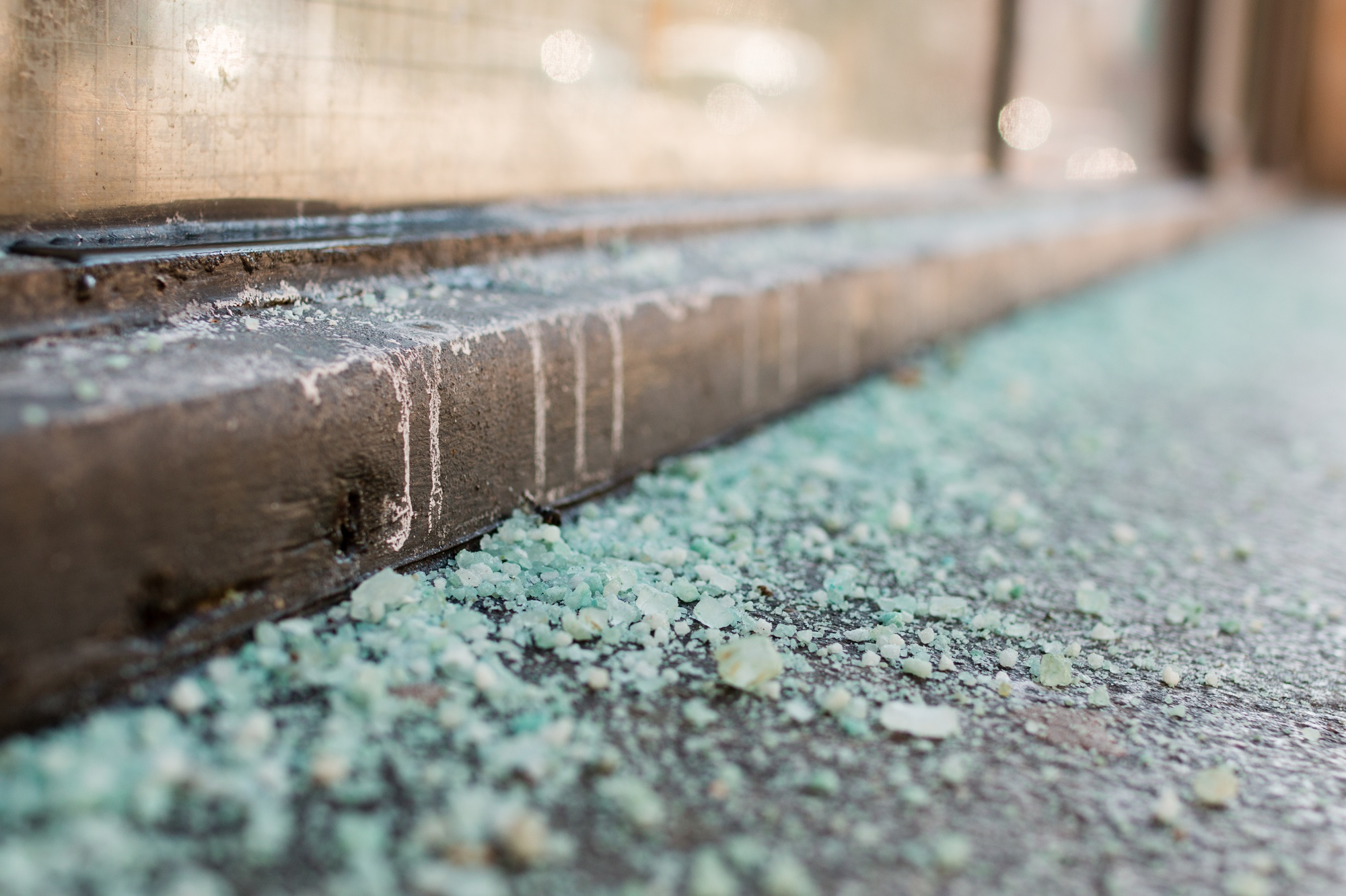 Salt lies on the sidewalk of Plympton Street as the snow-cleanup comes to a end.