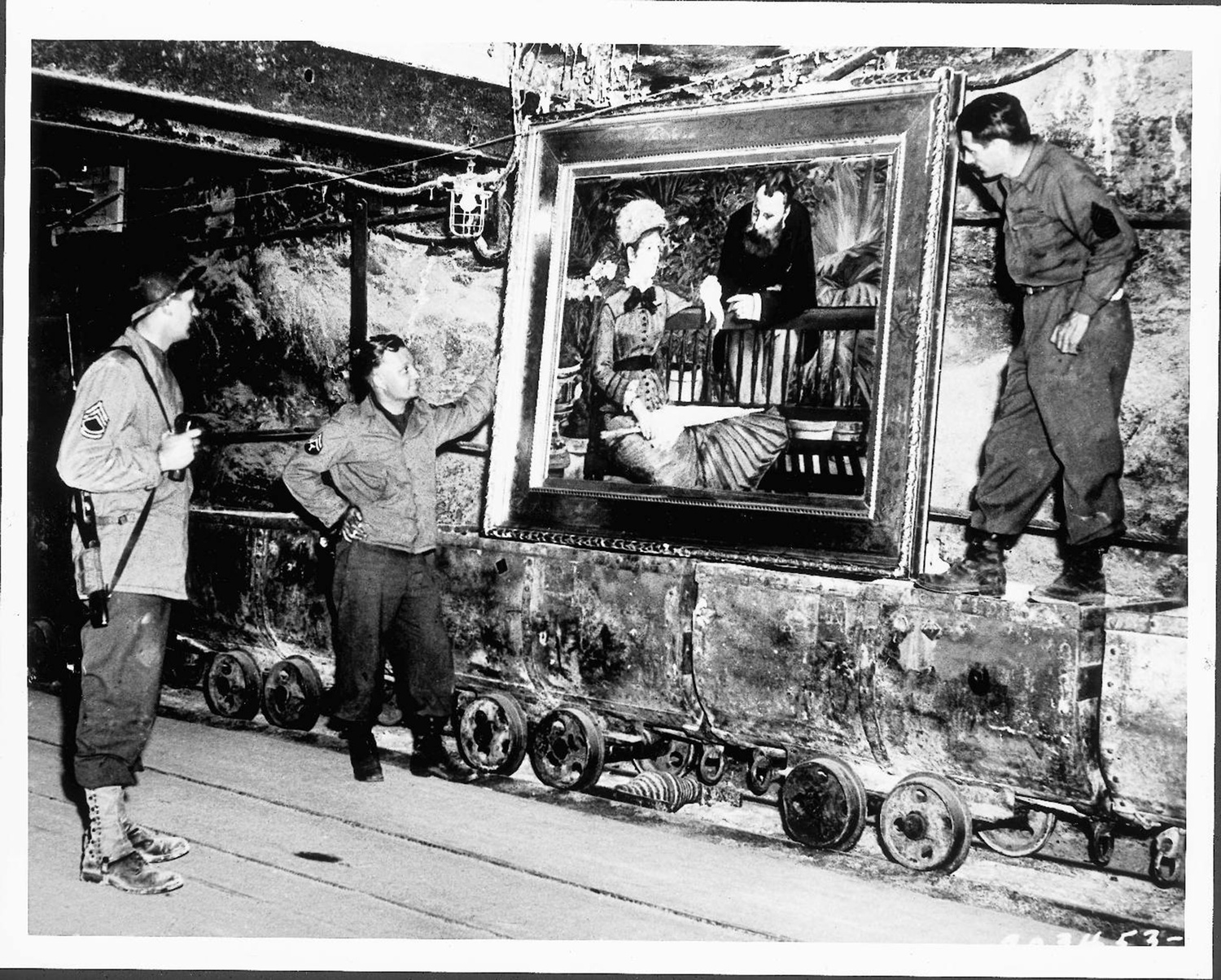 American soldiers with a recovered Manet painting in a salt mine.
