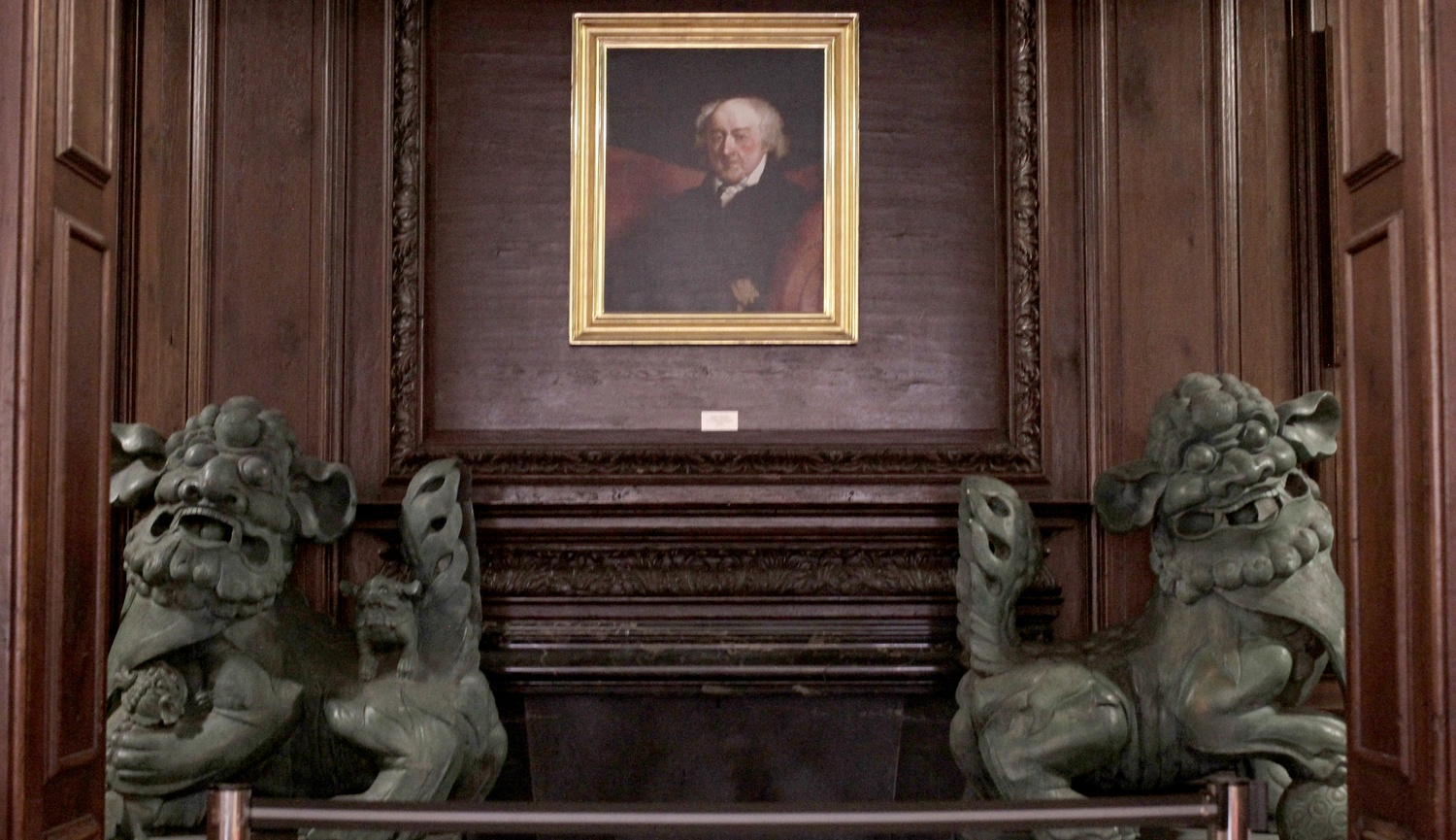 A portrait of John Adams hangs between two Chinese dragon sculptures in Adams House.