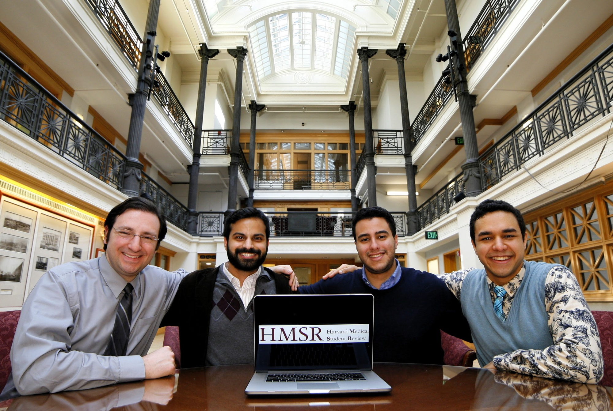 HMS students Noor M.R. Beckwith '11, Omar Abudayyeh, and Jay Kumar and teaching assistant Adam Frange, founders of the Harvard Medical Student Review, pose together for the launch of the online journal.