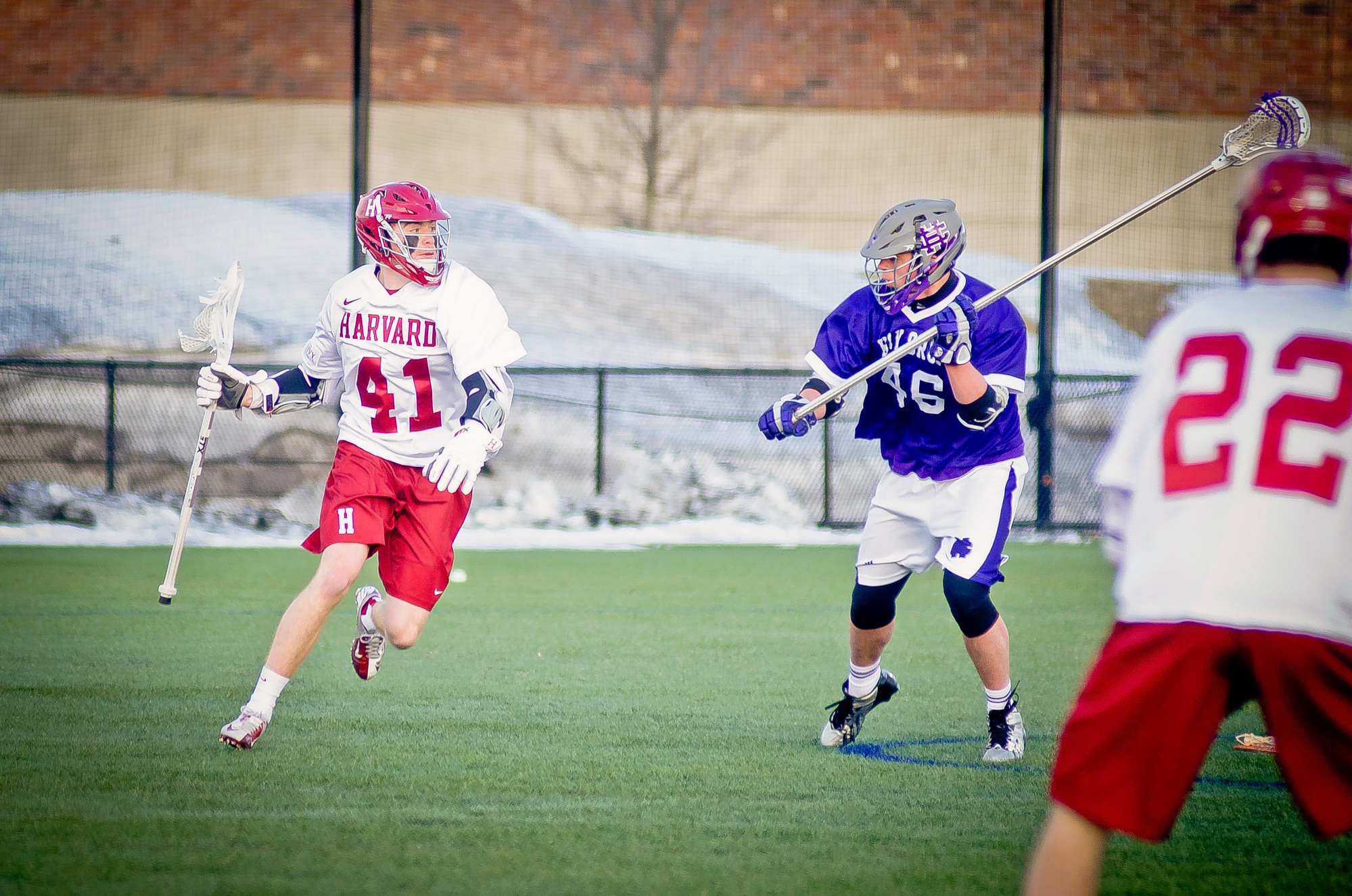The men's lacrosse team, shown here in earlier action, closed out nonconference play with a win over BU, 14-9.