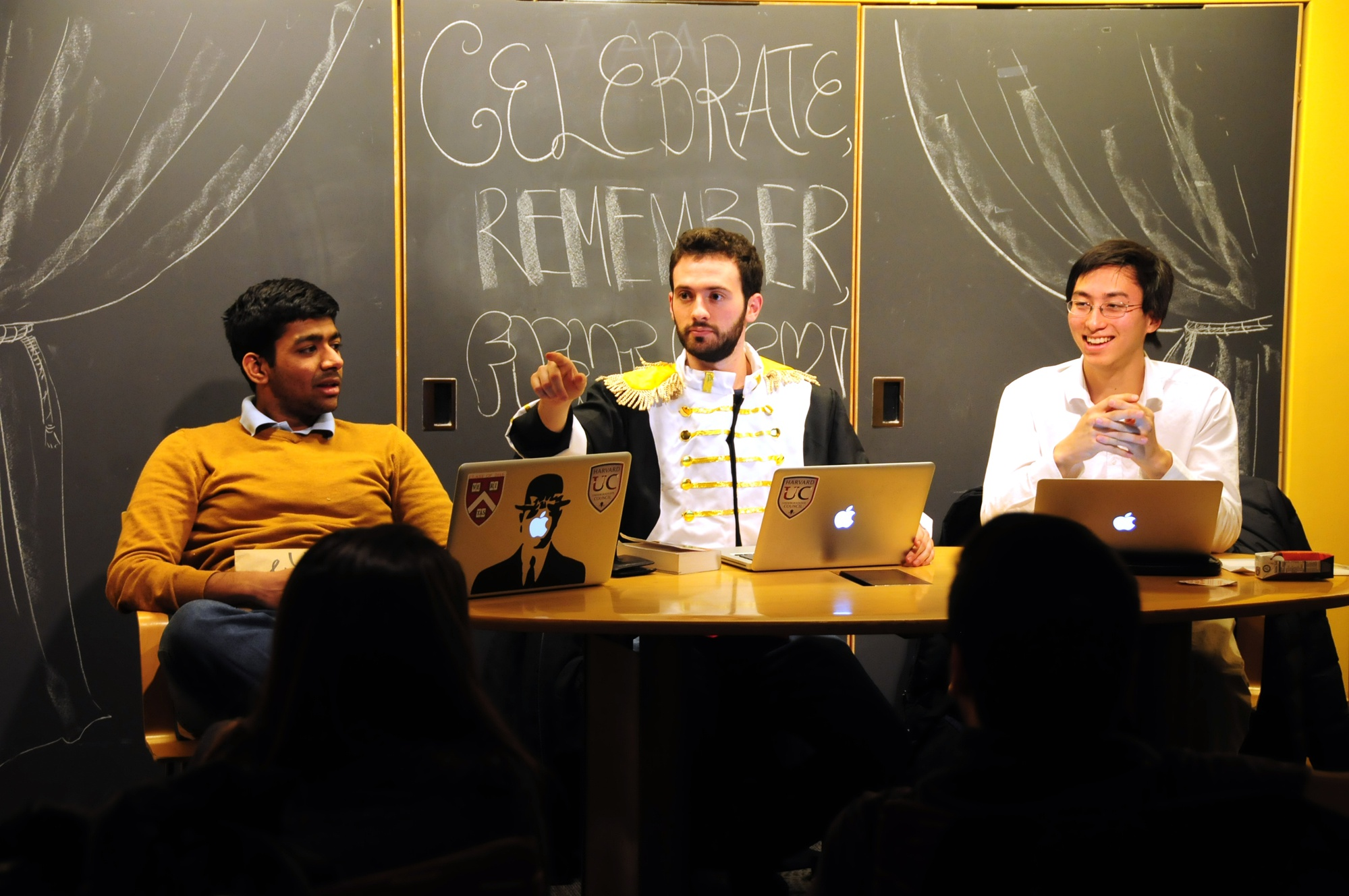 UC Treasurer Meghamsh Kanuparthy '16, left, President Gus A. Mayopoulos'15, center, and Vice-President Sietse K. Goffard'15, right, facilitate a discussion on the Council's progress in pursuing additional funding avenues.