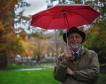 Dean Pfister with an umbrella