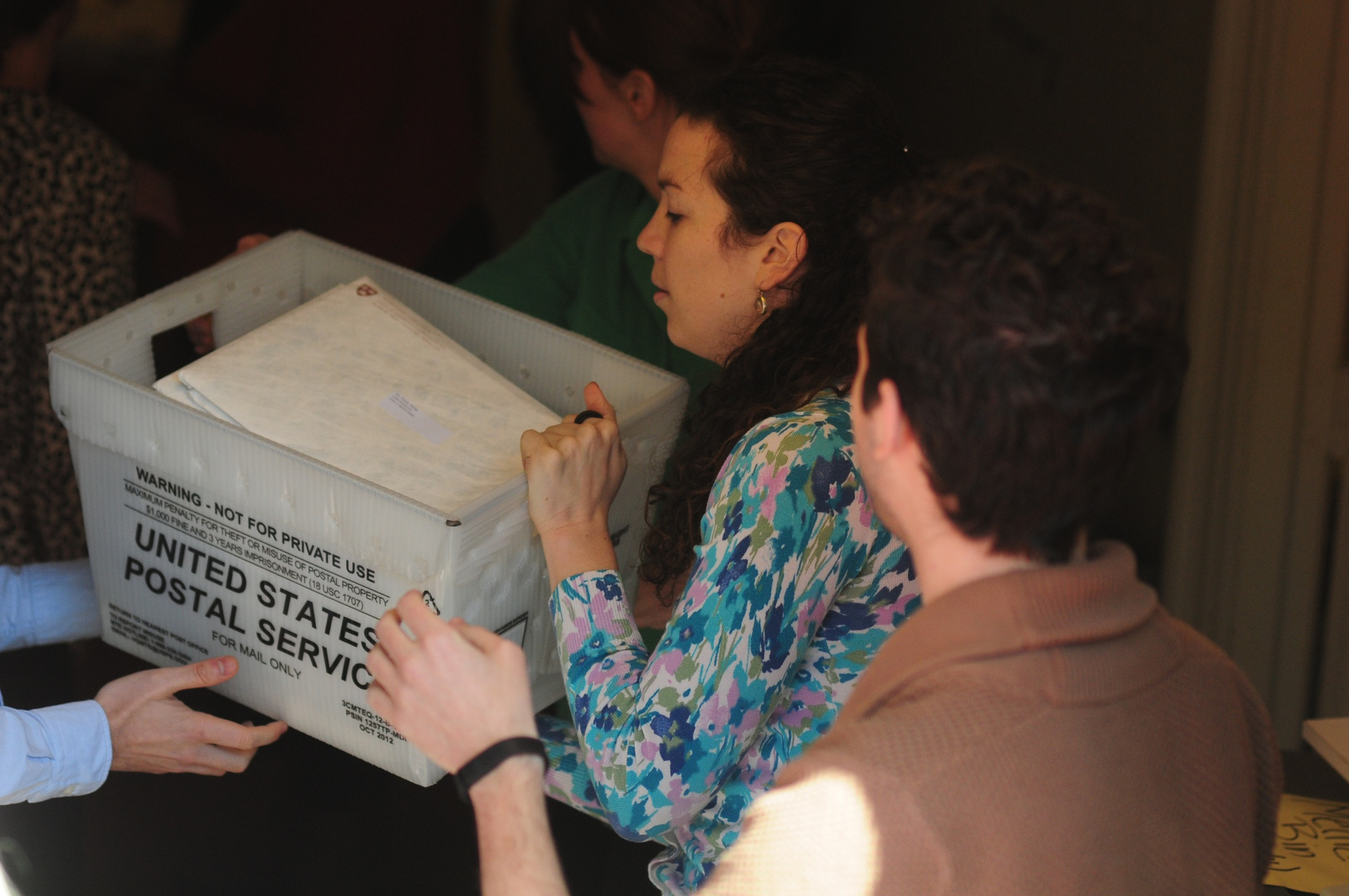 Members of the Admissions Office hand off the boxes of acceptance letters.