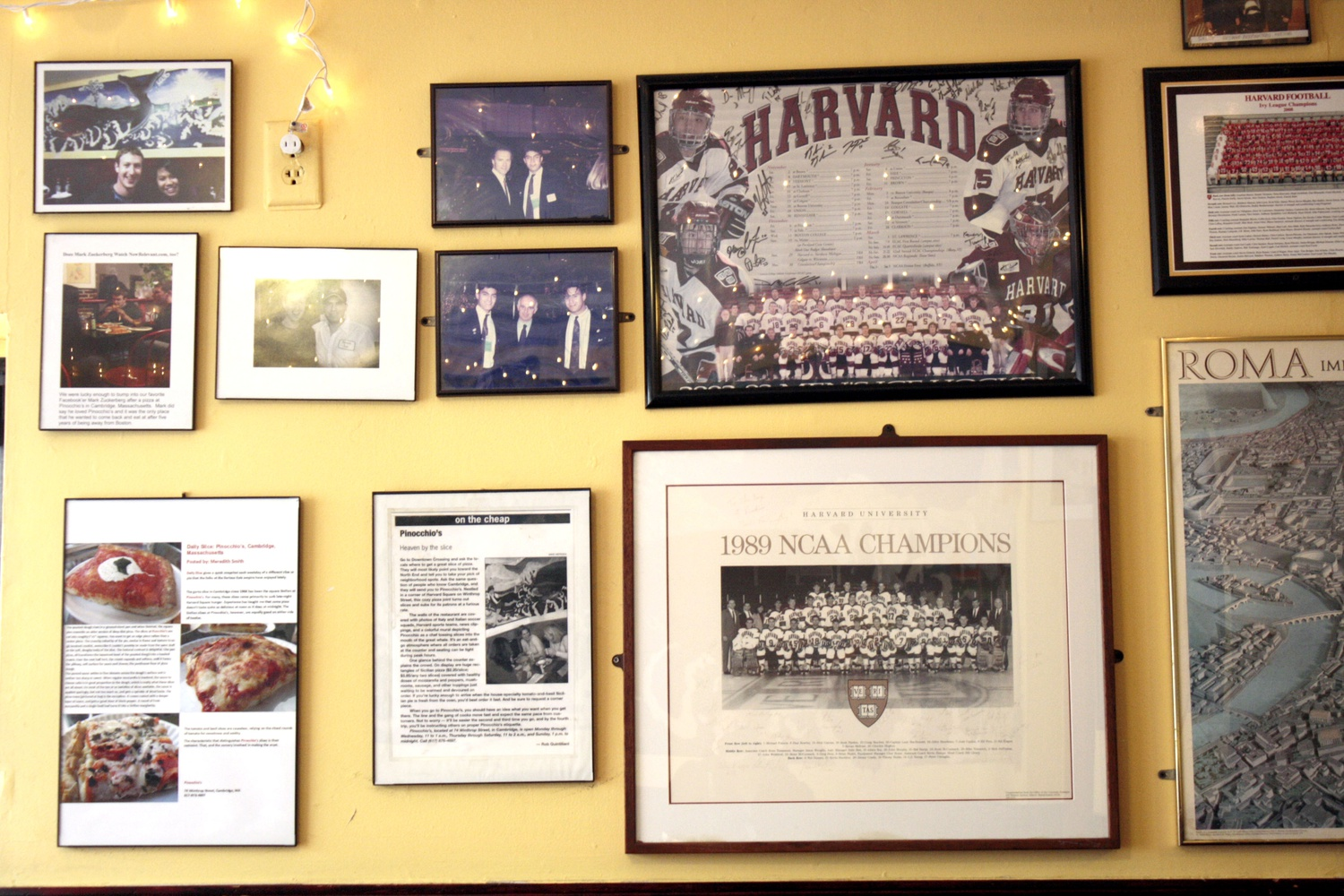 Photos adorn the walls of Pinocchio's Pizza & Subs, relating its rich history in Harvard Square.