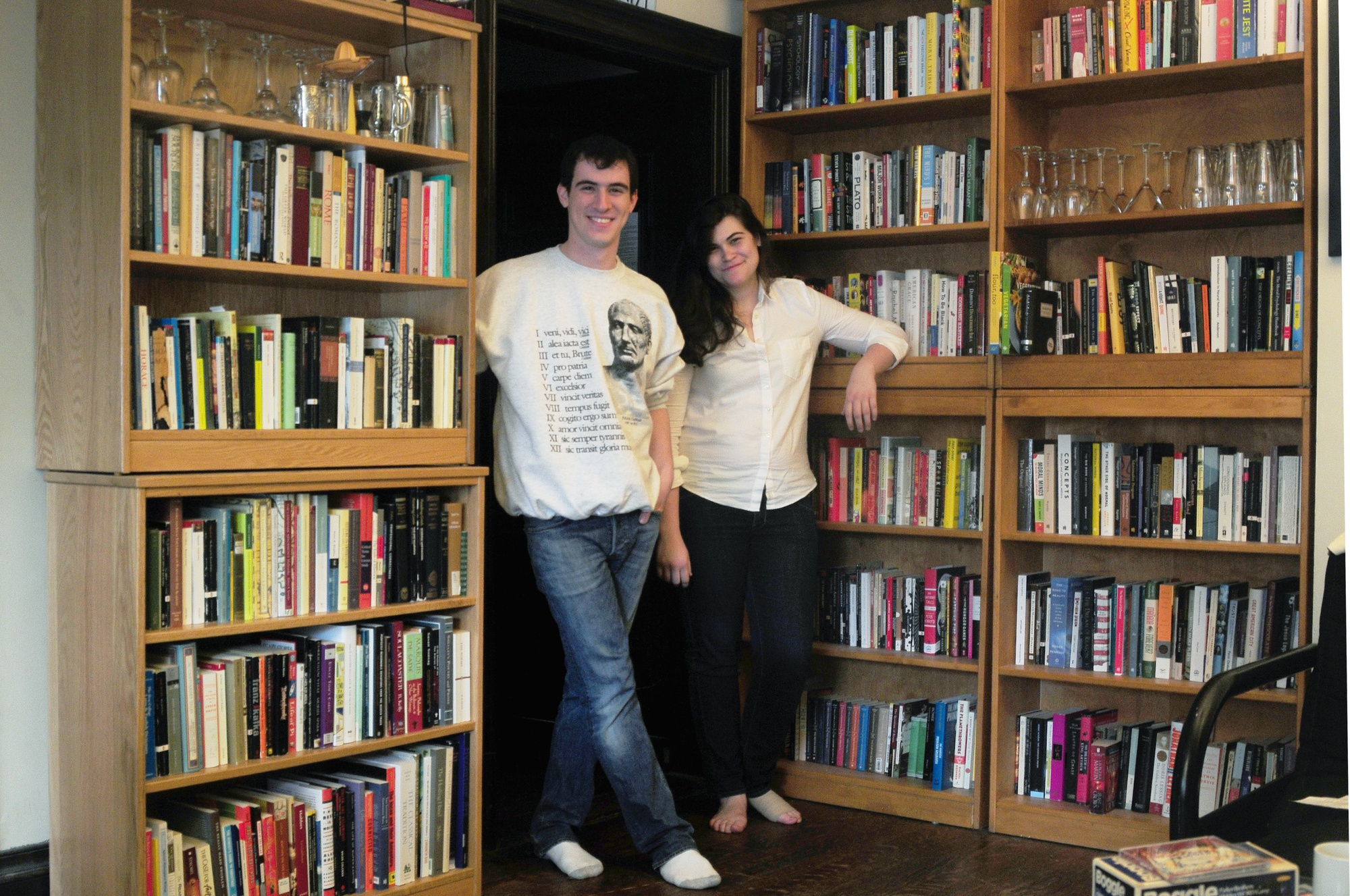Elliot A. Wilson '15 and Sarah E. Coughlon '15 pose with their book collections. They are good friends but like to get competitive about their reading choices.