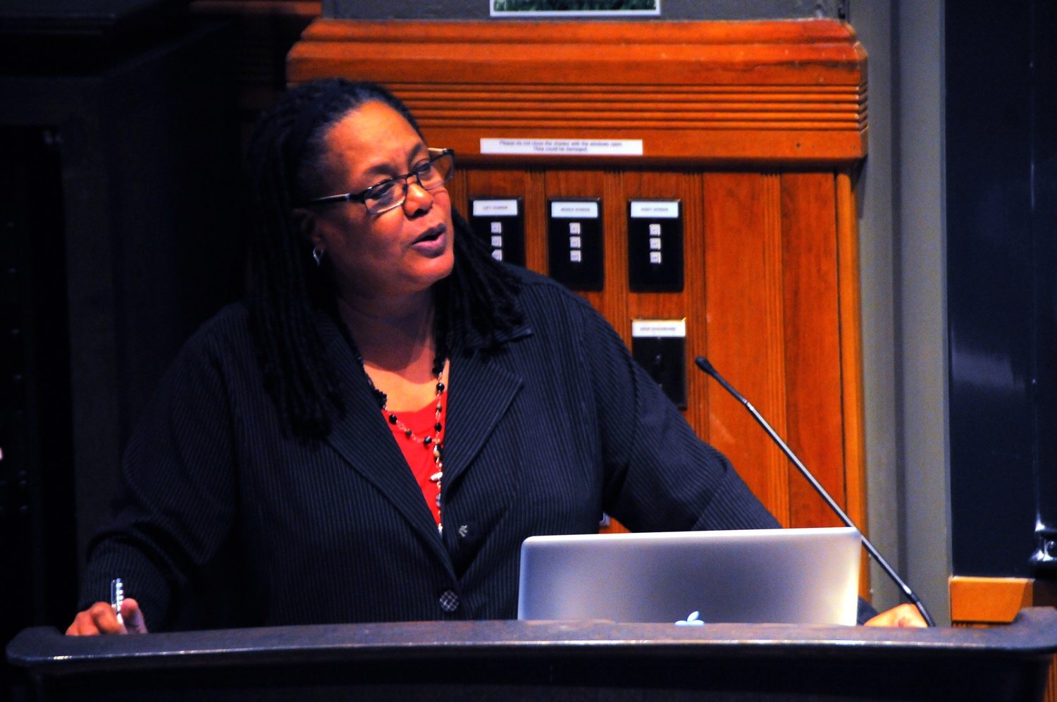 Evelynn M. Hammonds, shown speaking at the Harvard College Governance panel in a file photo from last November, is on a sabbatical leave after five years as dean of Harvard College.