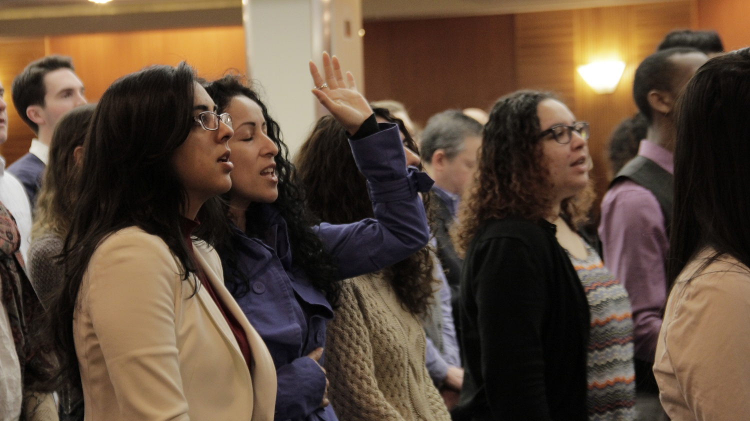 Members of the Boston Church of Christ sing at Sunday service on April 6.