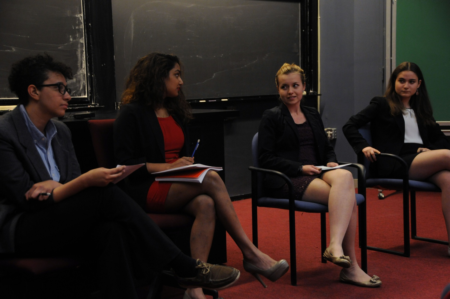 "From left to right, Brianna J. Suslovic '16 and Sasanka N. Jinadasa '15 debate against Mirta Stantic '15 and Lisa J. Mogilanski '15 on whether the strategies in Sheryl K. Sandberg's '91 book, ""Lean In,"" are applicable to all women."