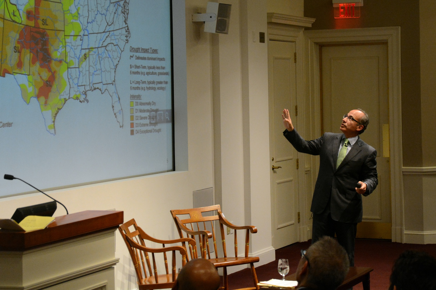 """Felipe Calderon references a map of the United States while speaking at his lecture """"Climate Change and Business"""" at Harvard Business School on April 4."""