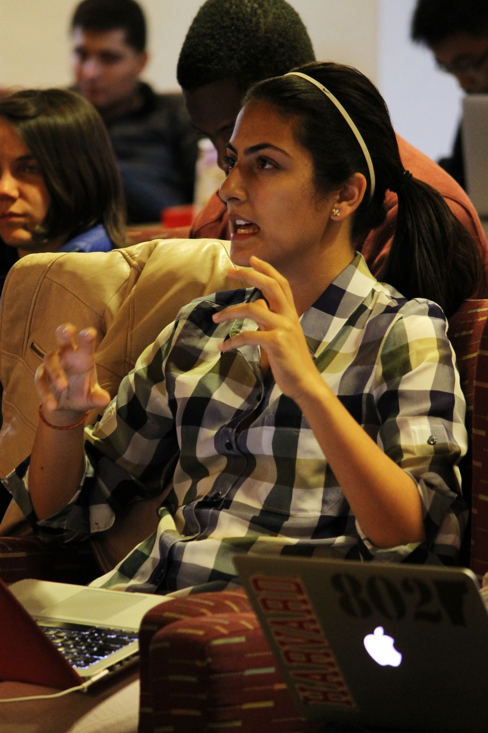Ava Nasrollahzadeh '16 poses a question about HBX at the UC meeting on Sunday night in Ticknor Lounge. Nasrollahzadeh, UC chair of Student Relations, later presented the launch of the new UC website during the meeting.