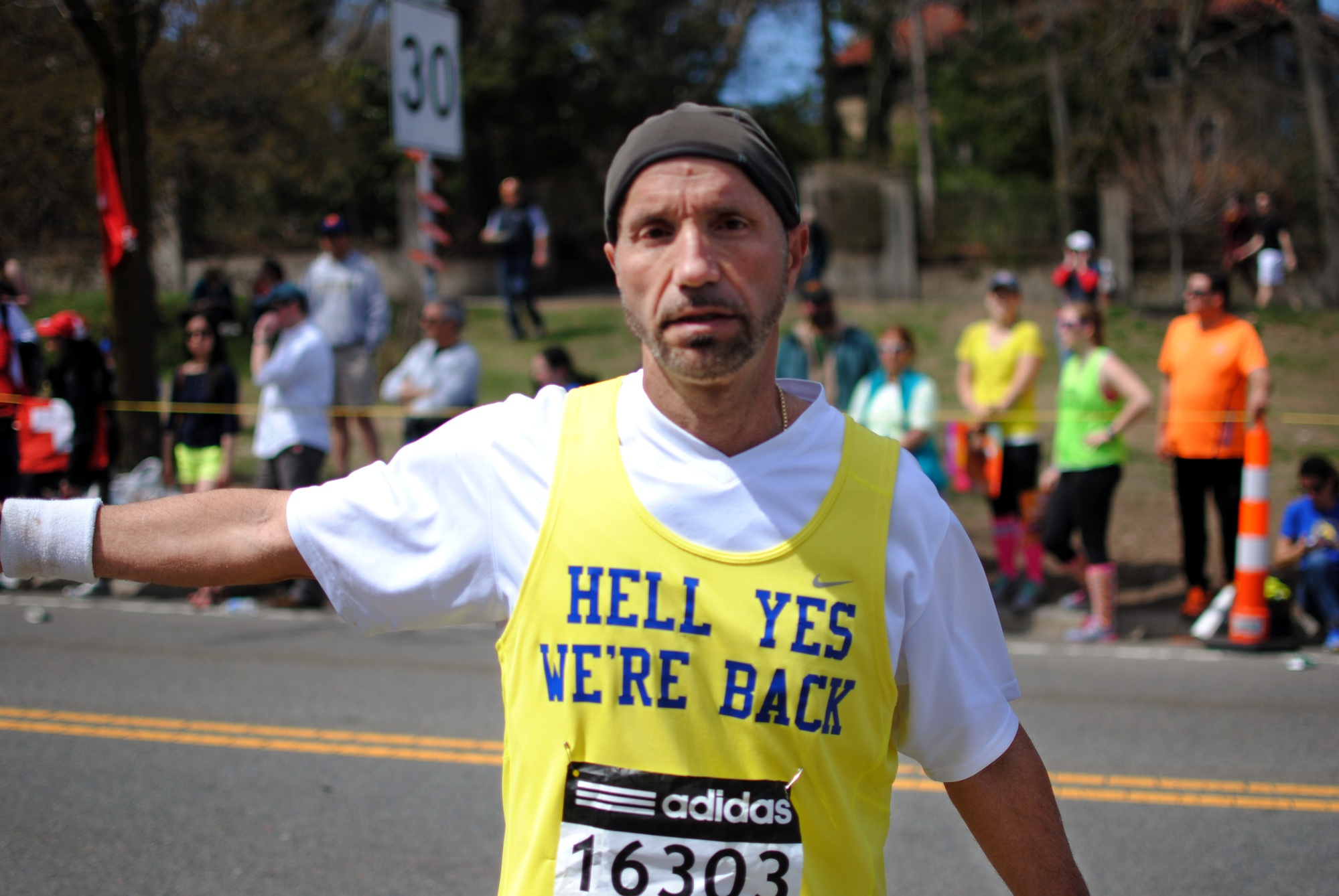 Joey Phillips of Cuyahoga Falls, USA pauses at mile 21 after reaching the summit of Heartbreak Hill at the 2014 Boston Marathon.