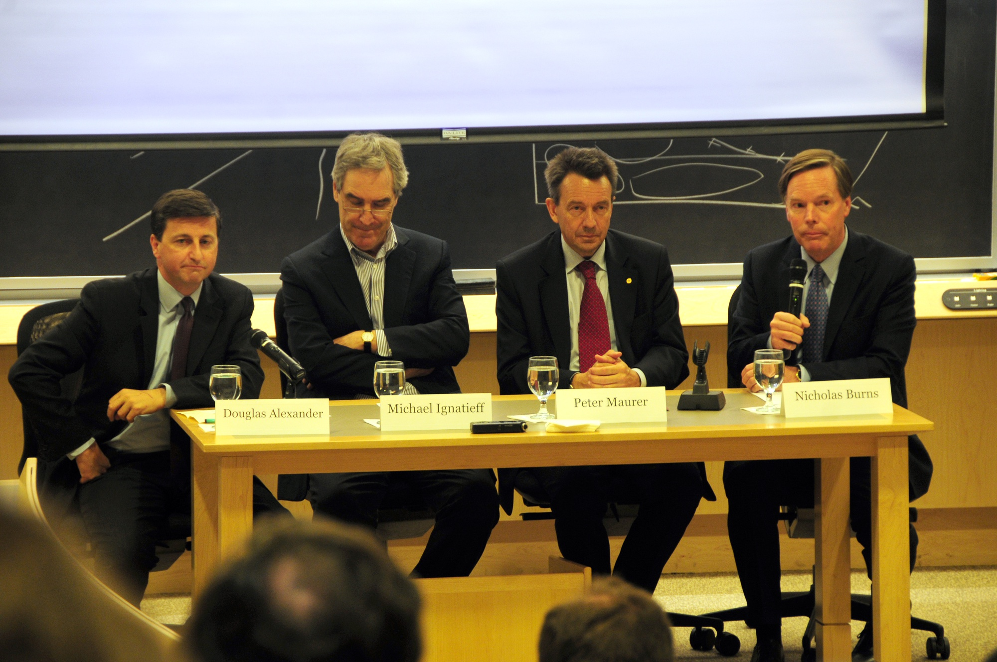 Peter Maurer, right, Douglas Alexander, left, and Michael Ignatieff, center, discuss the current situation in Syria and the Middle East. The panel was moderated by Nicholas Burns.
