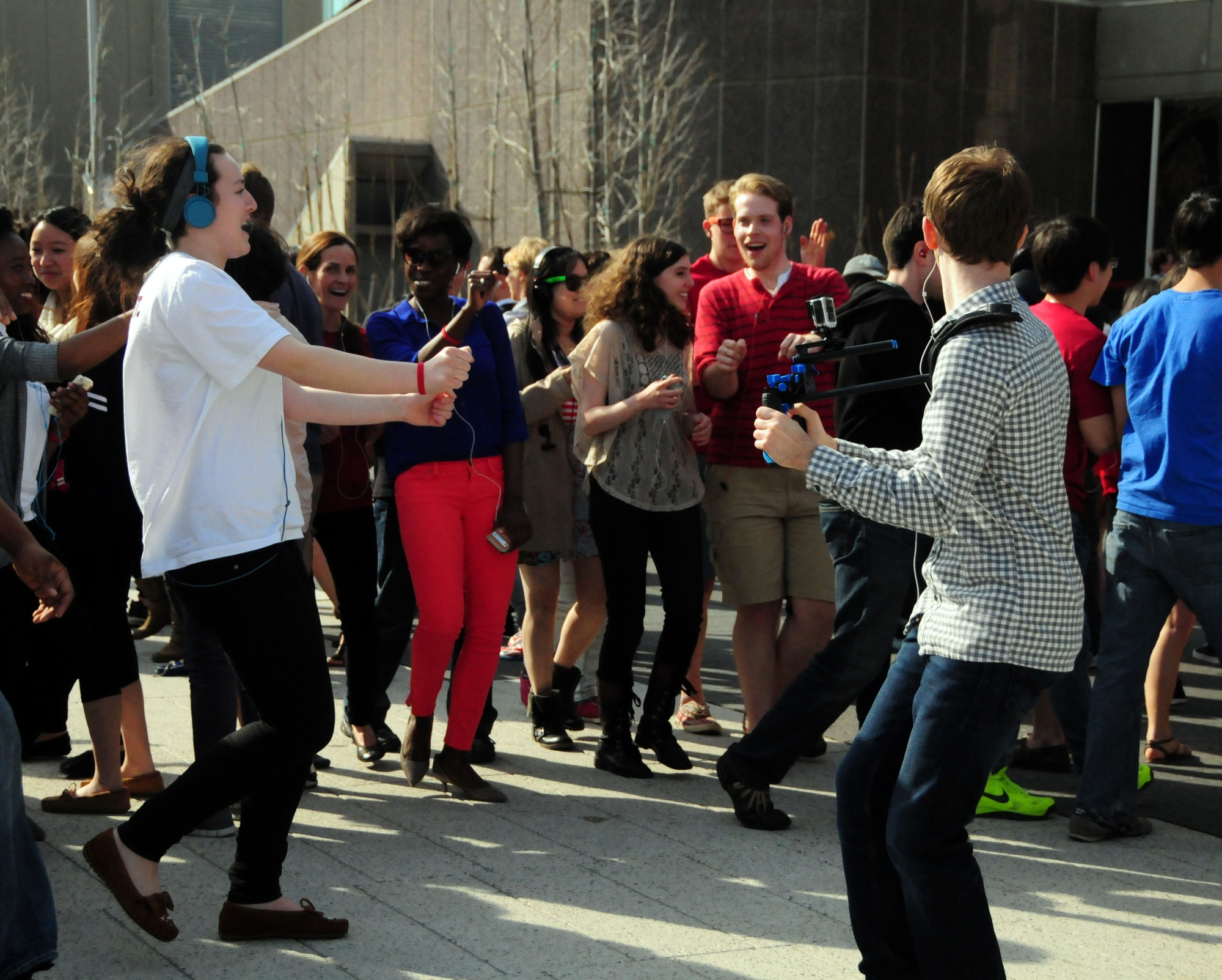 Students take part in a flash mob as part of Mob Malaria on World Malaria Day.