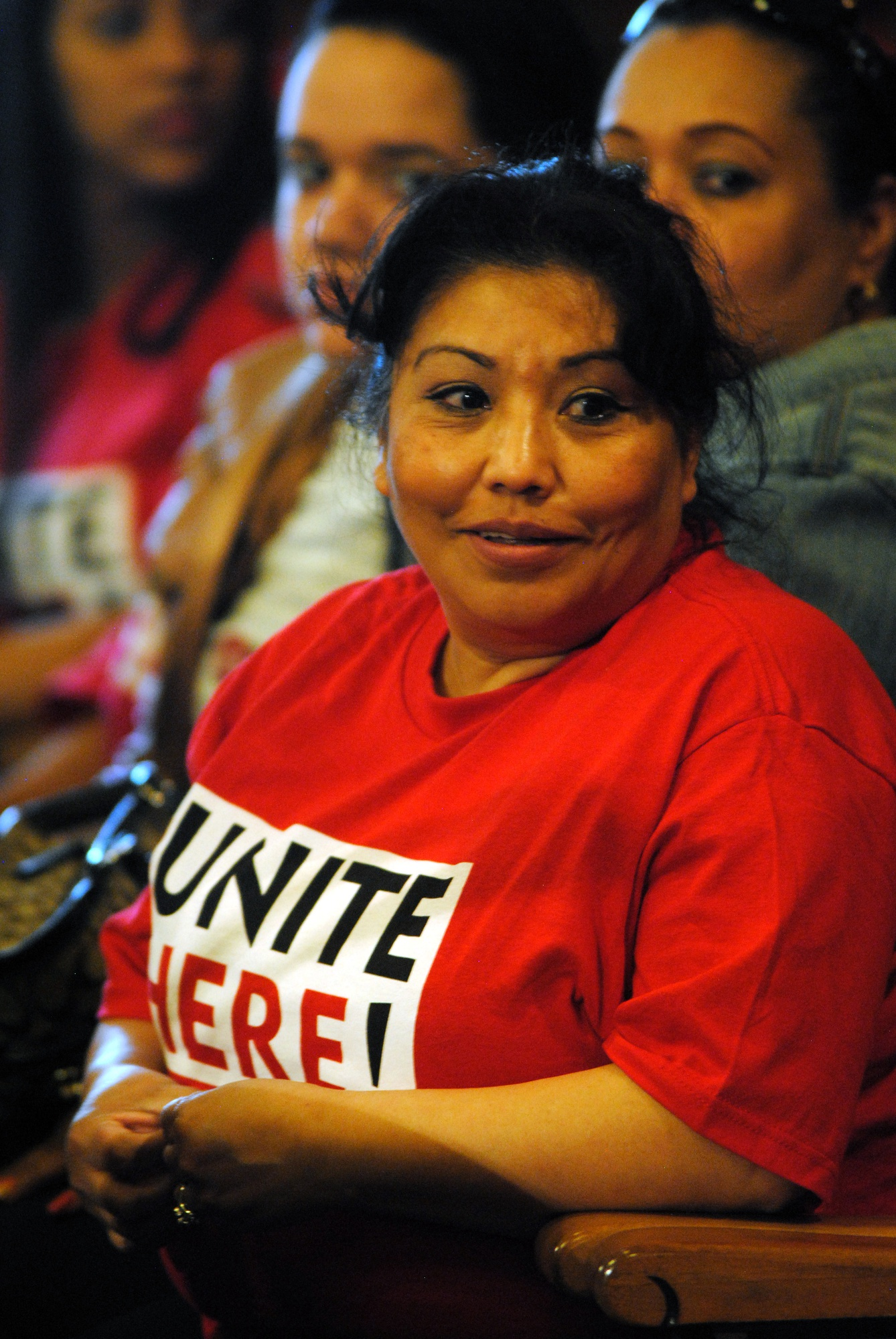 "Sandra Herandez, an employee of the Doubletree Hotel in Allston, waits to give a statement at the Cambridge City Council meeting on April 28. A housekeeper at the hotel for twenty two years, Hernandez exclaimed ""I'm here for a fair process""."