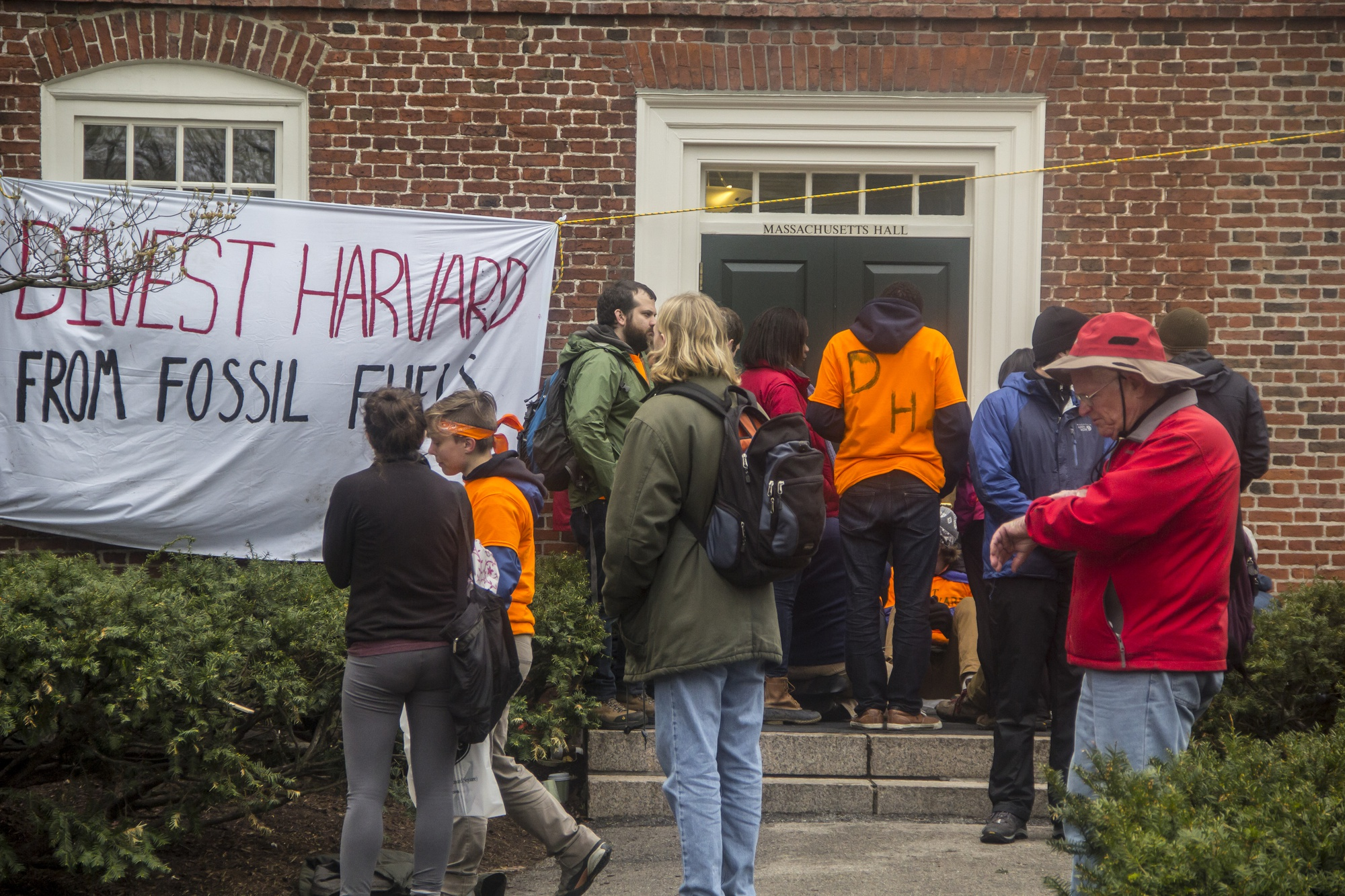Divest Harvard activists blockaded one of the entrances in front of Massachusetts Hall to protest against the University's continued investment in various fossil fuel companies.
