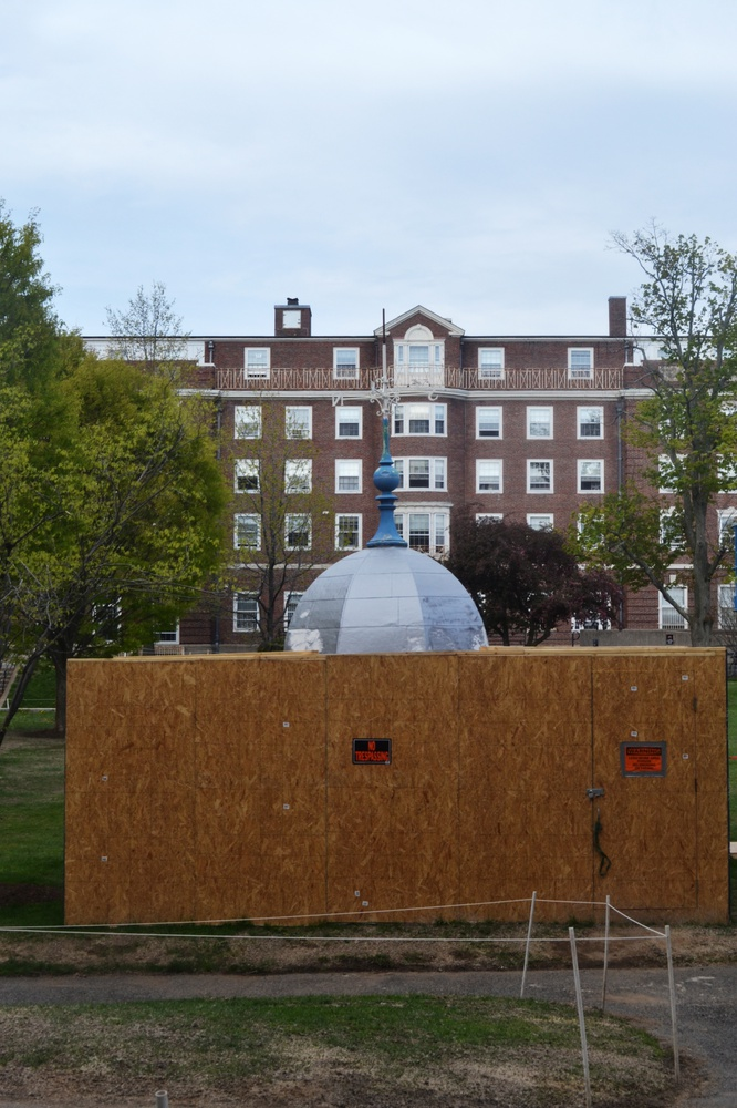 Briggs Hall's Cupola, from Cabot House, sits in the Radcliffe Quadrangle for restoration. The cupola will be host to a time capsule filled with contributions from students, to be opened in 2036.