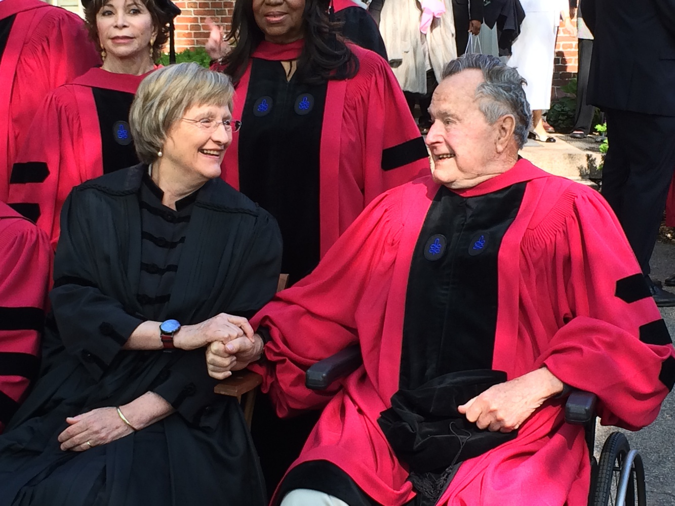 University President Drew G. Faust and President George H.W. Bush await the taking of a photograph outside of Massachusetts Hall Thursday morning, hours before Bush was to receive an honorary degree.