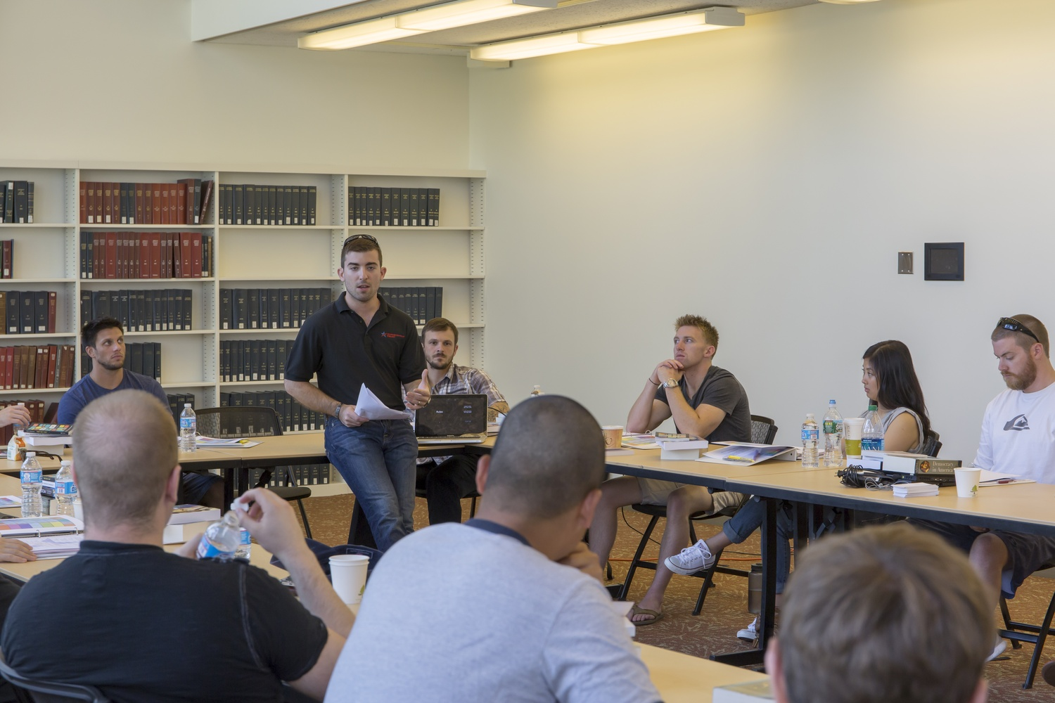 Logan Leslie '16, program director of the Warrior-Scholar Project at Harvard and a former Green Beret, speaks to participants of the Warrior-Scholar Project.