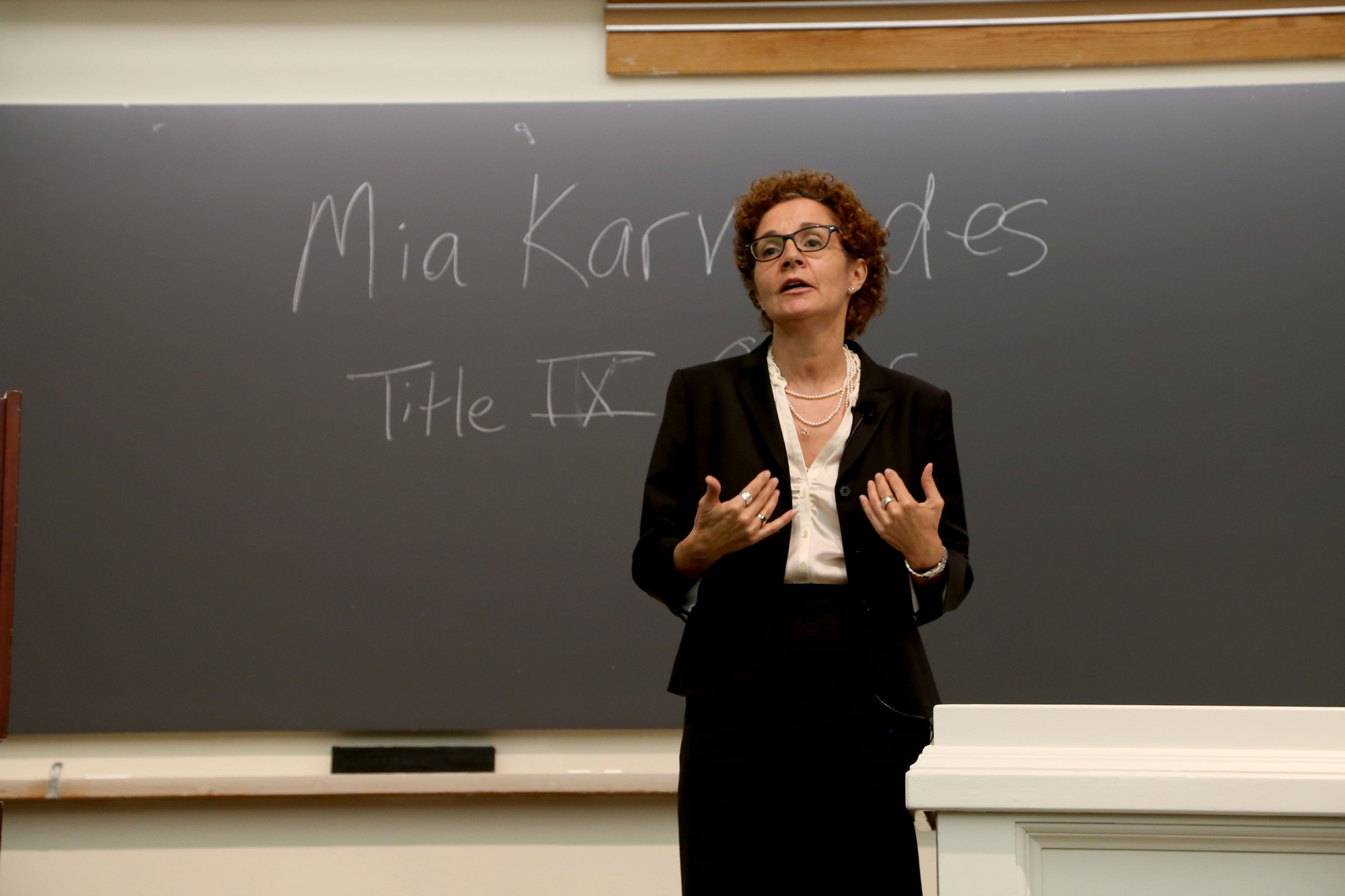 Mia Karvonides, Harvard's Title IX officer, speaks about Harvard's new sexual harassment policy and procedure. The community discussion, held in Emerson Hall, was the first in a series of meetings on the new policy open to Harvard affiliates.