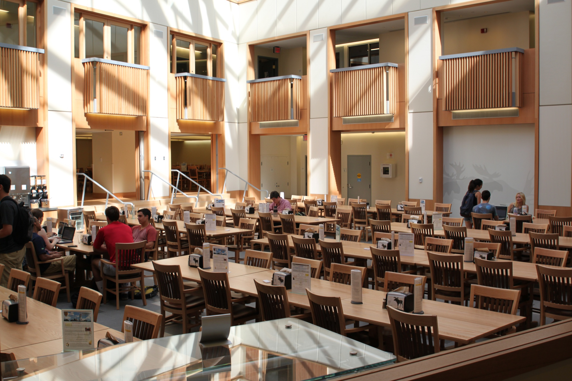 """Residents study in the dining hall at the Inn at Harvard, the """"headquarters"""" of Dunster House while its iconic building is being renovated."""
