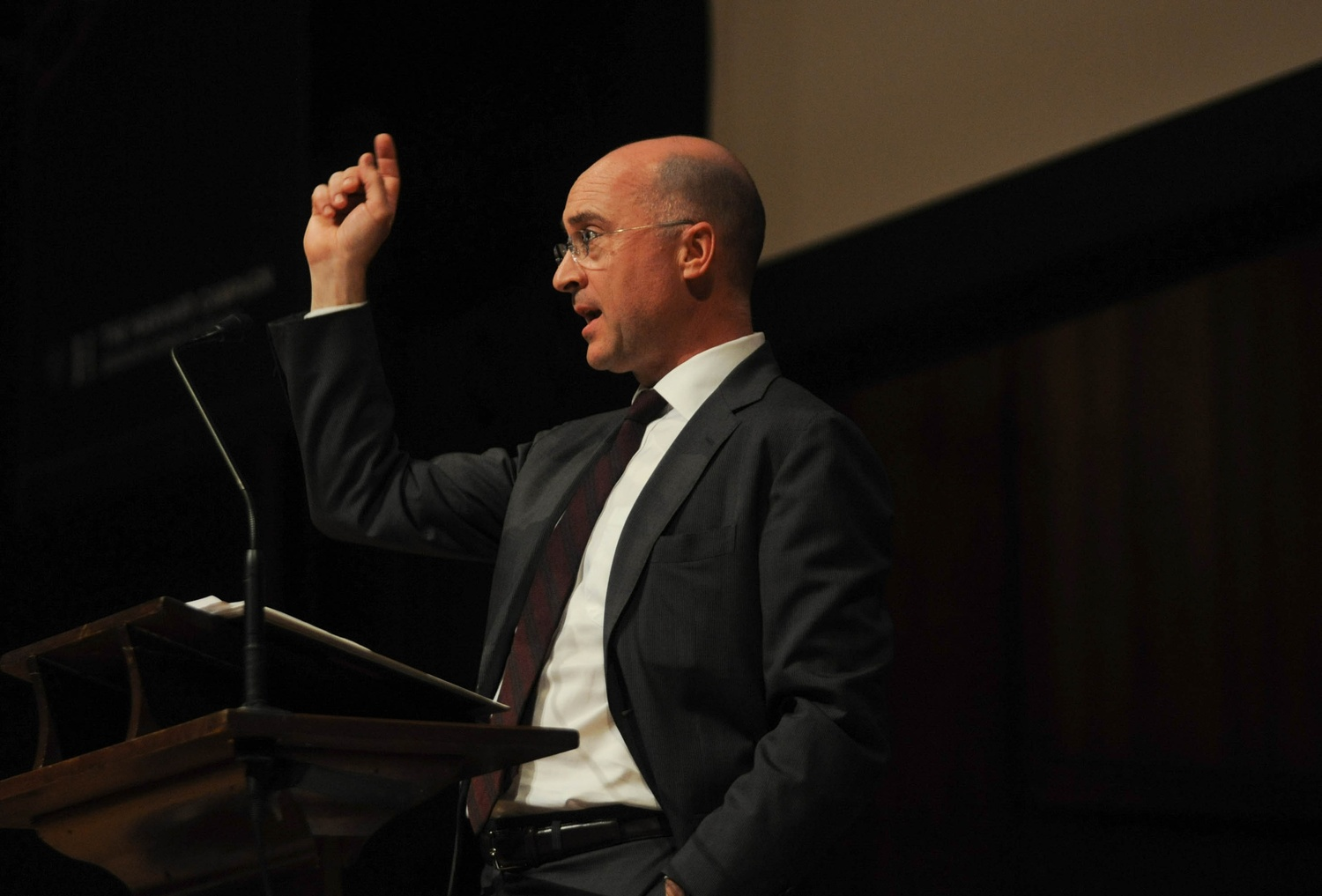 """Phil Harrison, president and CEO of global design firm Perkins+Will, speaks in Sanders Theatre alongside other affiliates of the Graduate School of Design. The speech kicked off the weekend """"Grounded Visionaries"""" event, as well as the campaign for the GSD."""