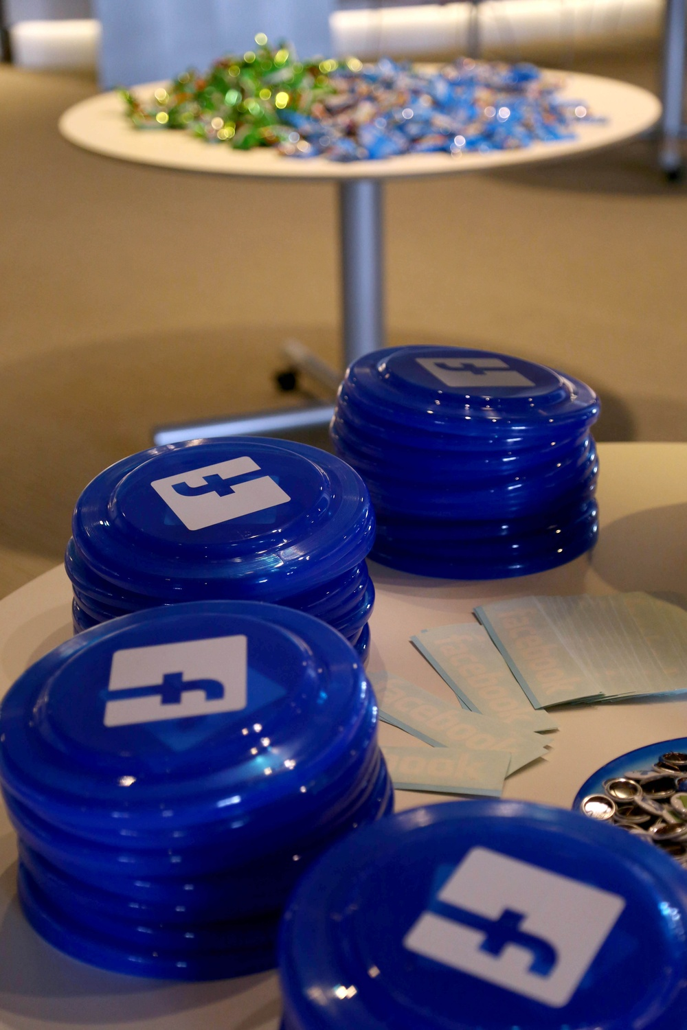A table full of Facebook paraphernalia rests next to another filled with snacks at CS50 Puzzle Day on September 6, 2014. The Facebook-sponsored event included a photobooth and electronic giveaways.
