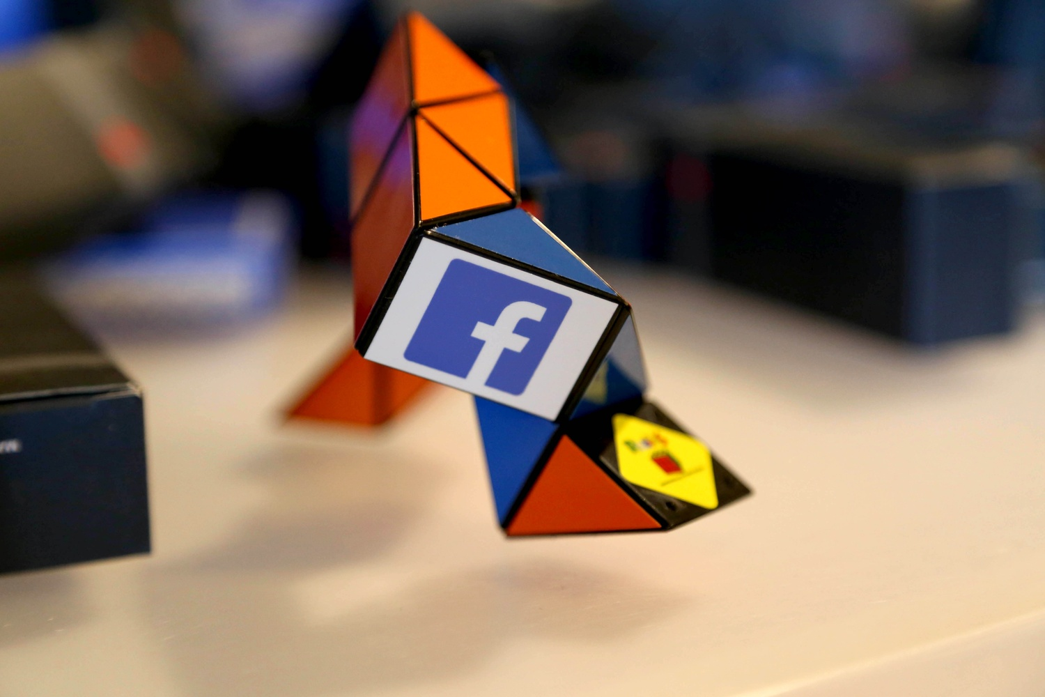 A rubik's snake rests on a table at CS50 Puzzle Day on September 6, 2014. The Facebook-sponsored event featured Facebook and CS50 paraphenalia and giveaways.