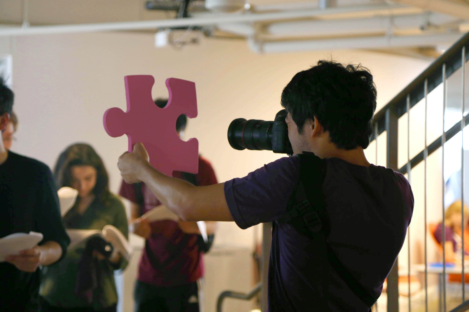 A CS50 staff photographer photographs a puzzle piece at CS50 Puzzle Day at the iLab on September 6, 2014.
