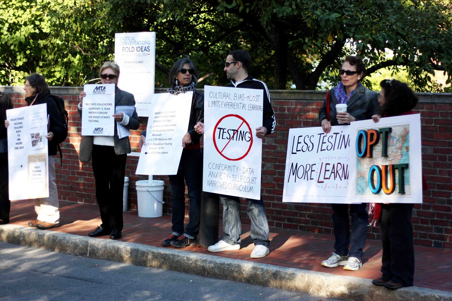 Members of Citizens for Public Schools, the Massachusetts Teachers Association, and other organizations stand outside the Graduate School of Education to protest against U.S. Secretary of Education Arne S. Duncan's policies on high-stakes testing.
